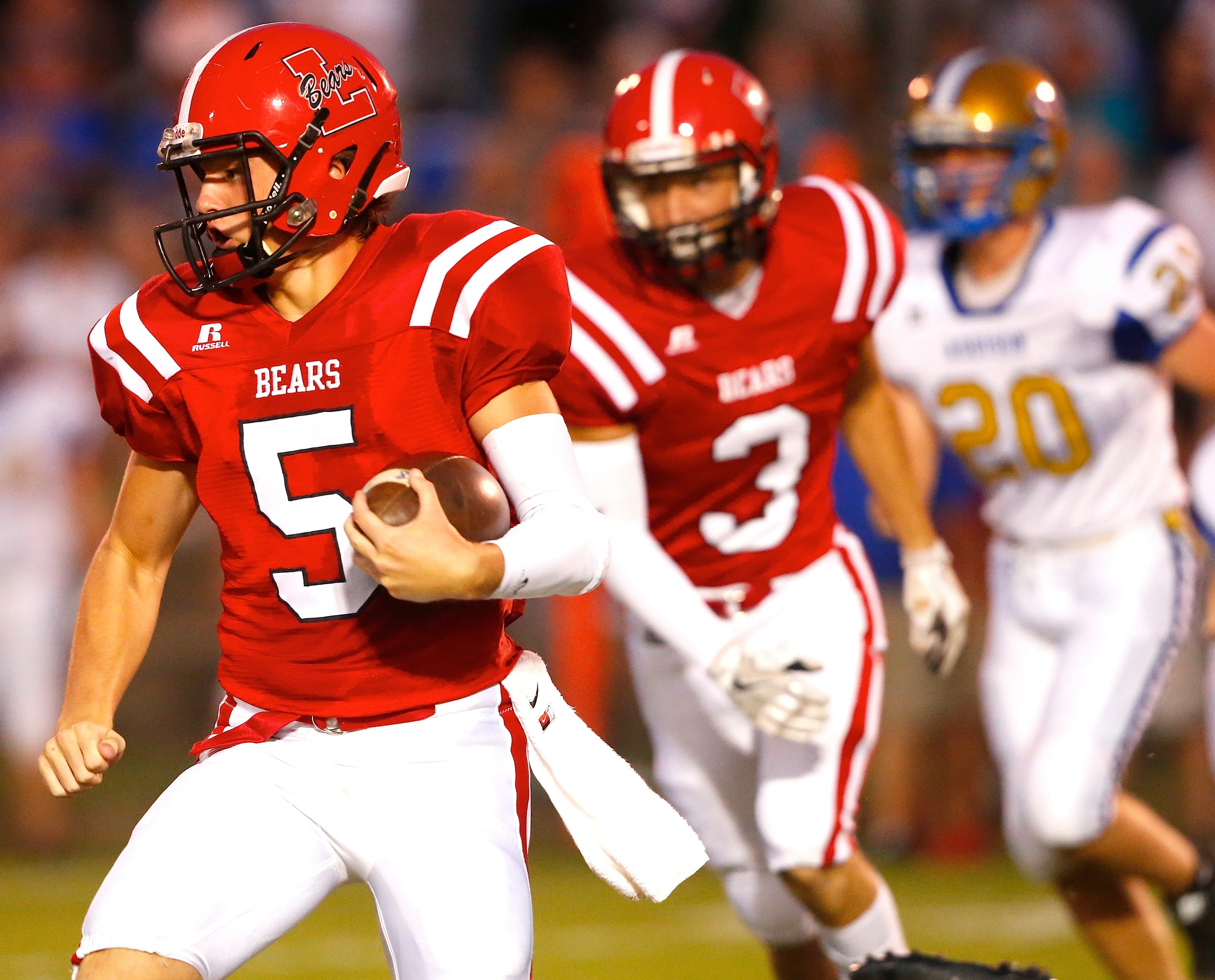 Lynn quarterback Noah Jackson (5) runs with Cameron Baldy (3) following in Friday's 21-18 win over No. 5 Addison at David Posey Memorial Stadium. Addison had won 14 straight regular-season games before Friday's loss.
