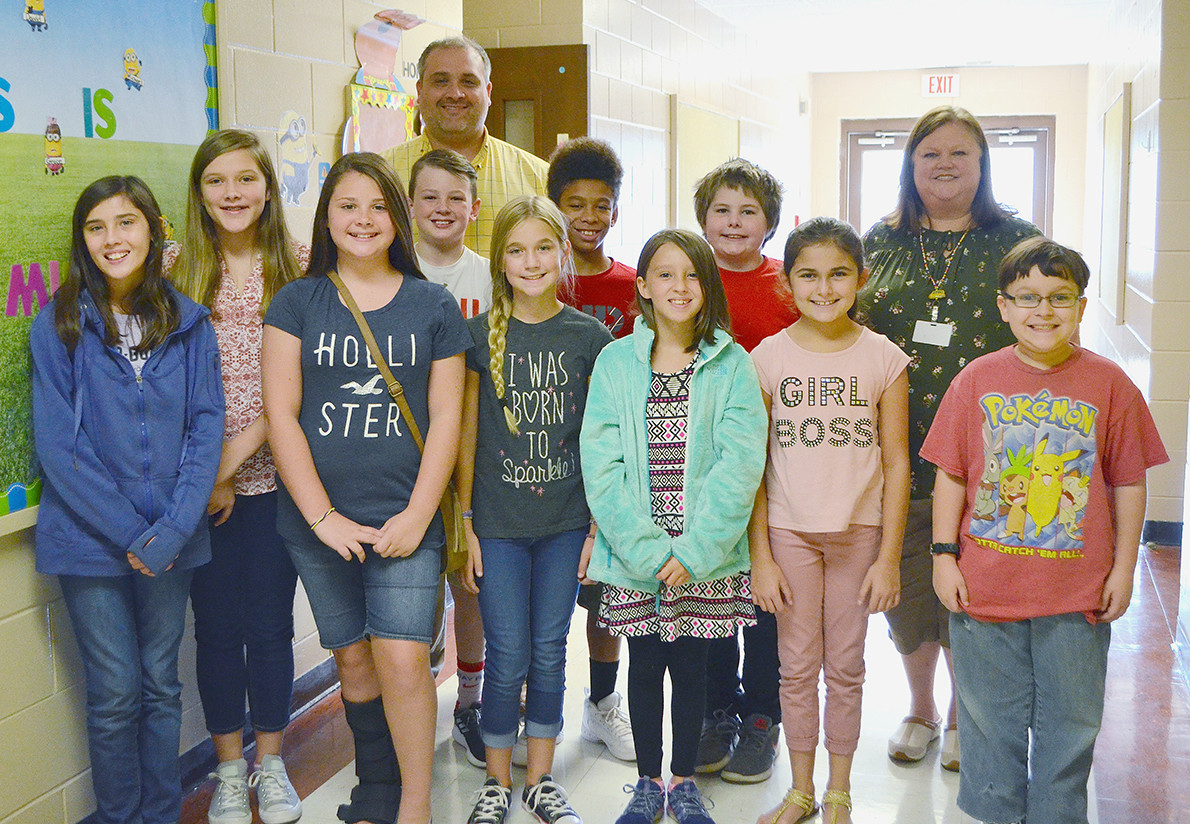 Pictured is Tornado TV club members at Parrish Elementary School. Also pictured is Parrish Principal Thomas Kyzer and teacher Susie Lamon.  Daily Mountain Eagle - Nicole Smith