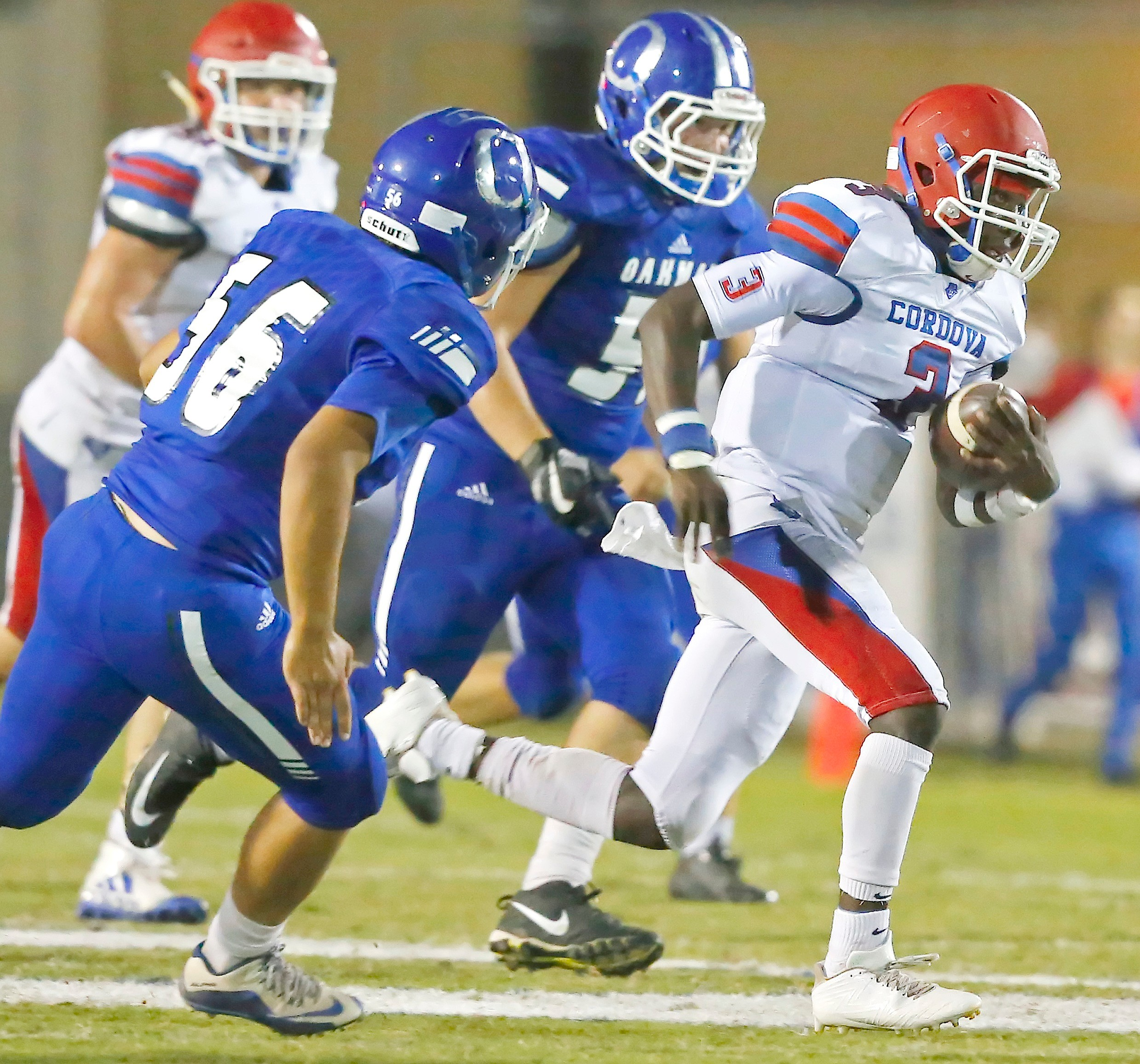 Cordova's Demetrius Kirk, right, picks up yardage against Oakman on Friday night. Kirk totaled 301 yards of offense in the Blue Devils' 20-15 victory at Oakman High School. Cordova has won three straight games.