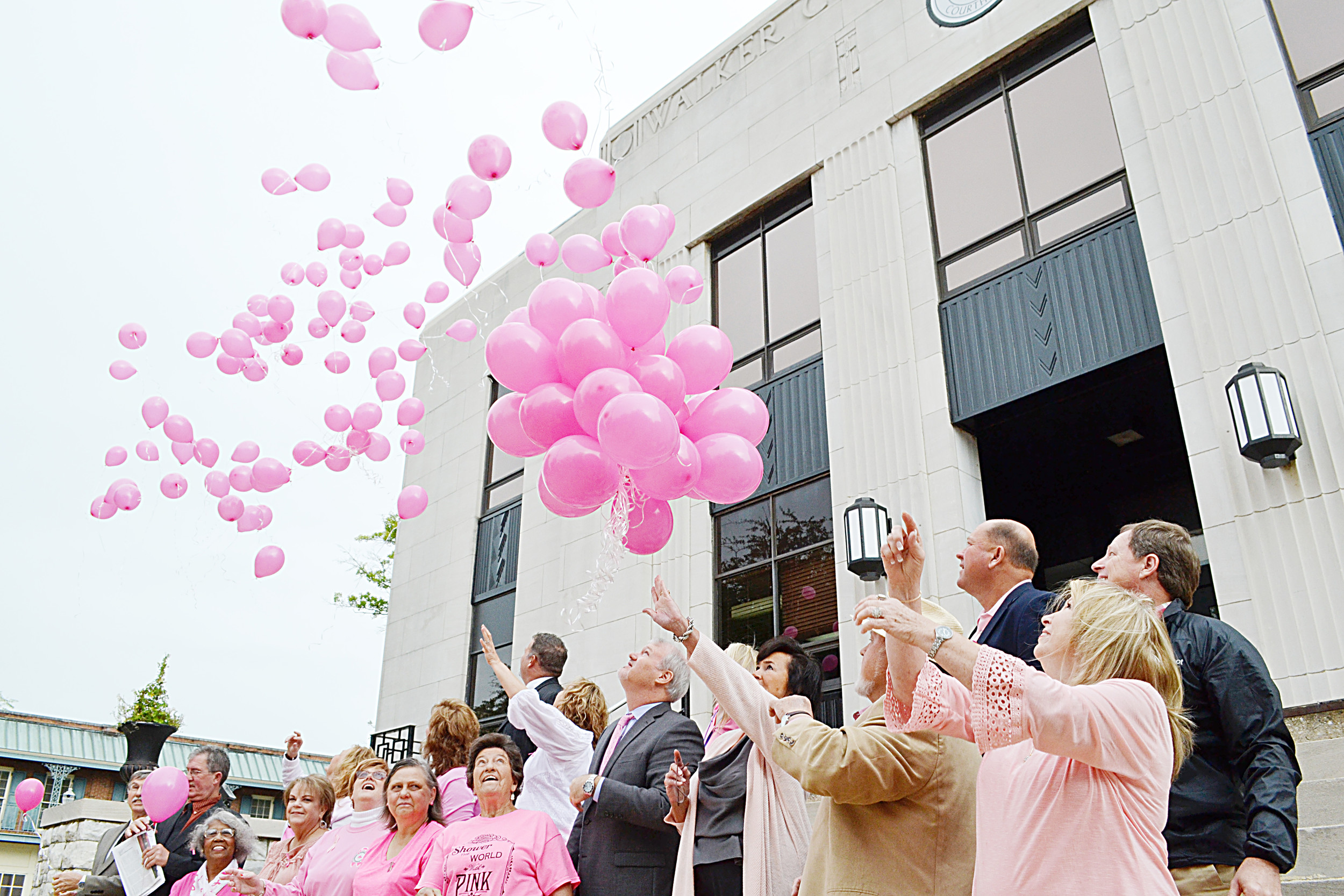Cancer survivors the Walker County Commission and other county officials released pink balloons on the steps of the Walker County Courthouse on Monday to note that October is Breast Cancer Awareness Month. The commission earlier passed a resolution to