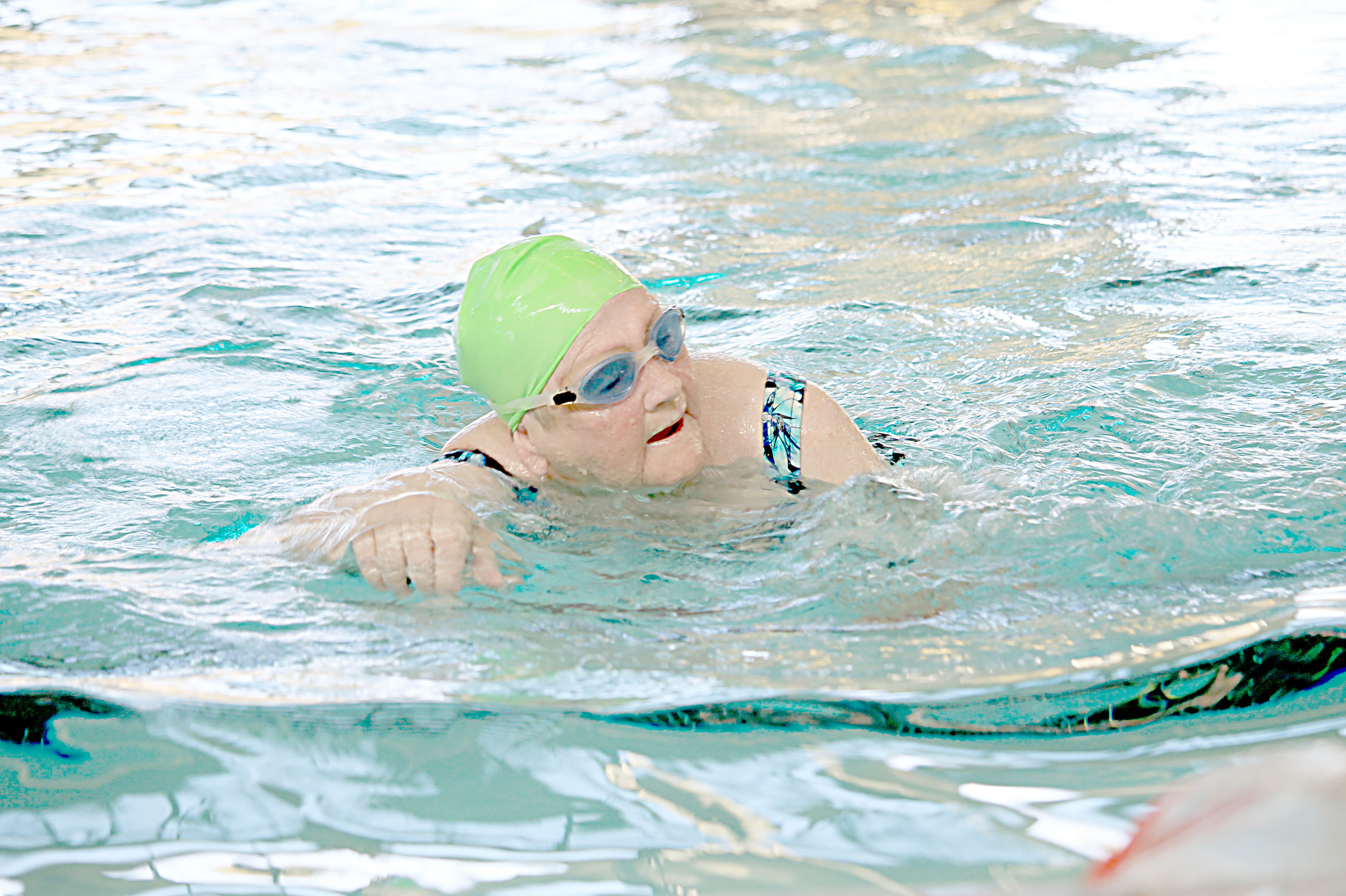 Ruth Barner swims at Memorial Park Natatorium's indoor heated pool Wednesday morning. More than 40 adults have learned to swim at the Natatorium in the past year. Daily Mountain Eagle - Jennifer Cohron