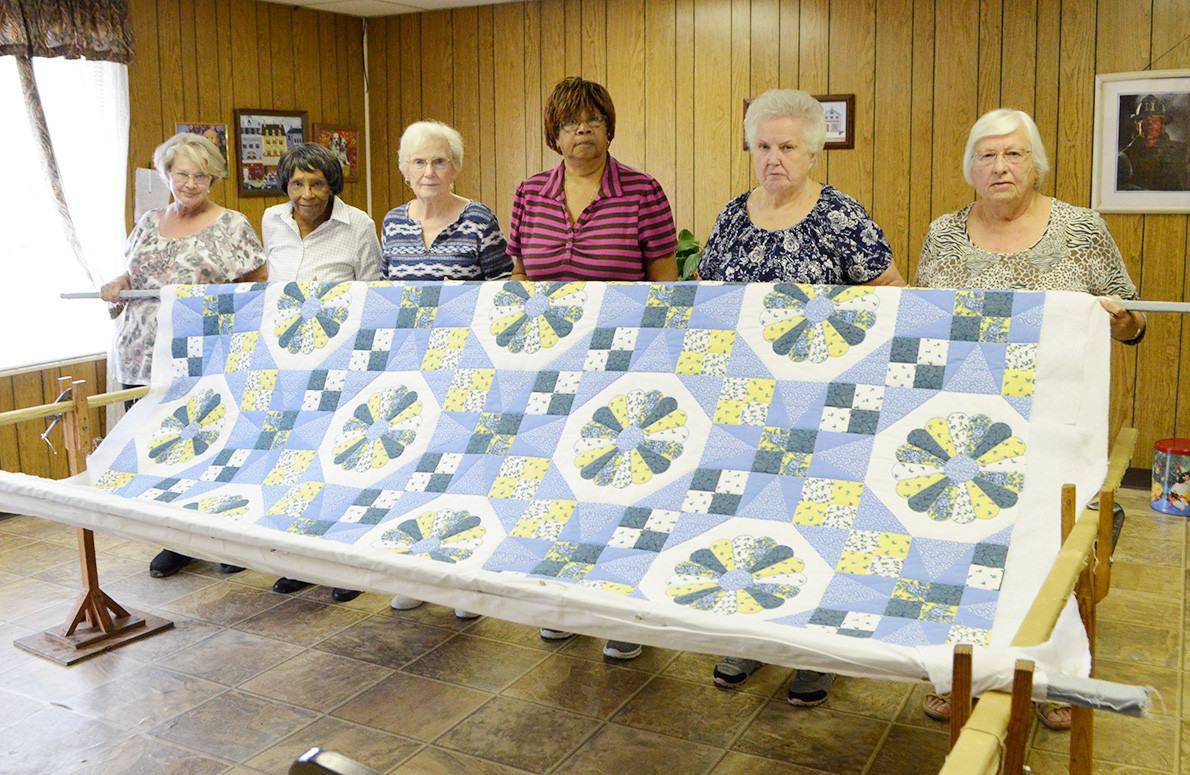 Women at the Oakman Senior Center have been working on a quilt that will be given away during the town's Day's Gap Fest.  Daily Mountain Eagle - Nicole Smith