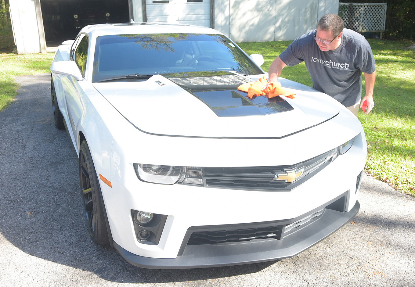 Deputy Fire Chief Alan Clark puts a shine on a 2015 Chevy Camaro ZL1 belonging to his wife, Diane, that will be part of Saturday's Central Alabama Rodders Society and Manchester Auto Parts 'Cruise In On The Square' car show. The annual event attracts more than 400 of the finest antique and show cars from around the Southeast each year. This year's car show will be held Saturday in downtown Jasper from 9 a.m. until 2 p.m. Admission is free.   Daily Mountain Eagle - Ron Harris
