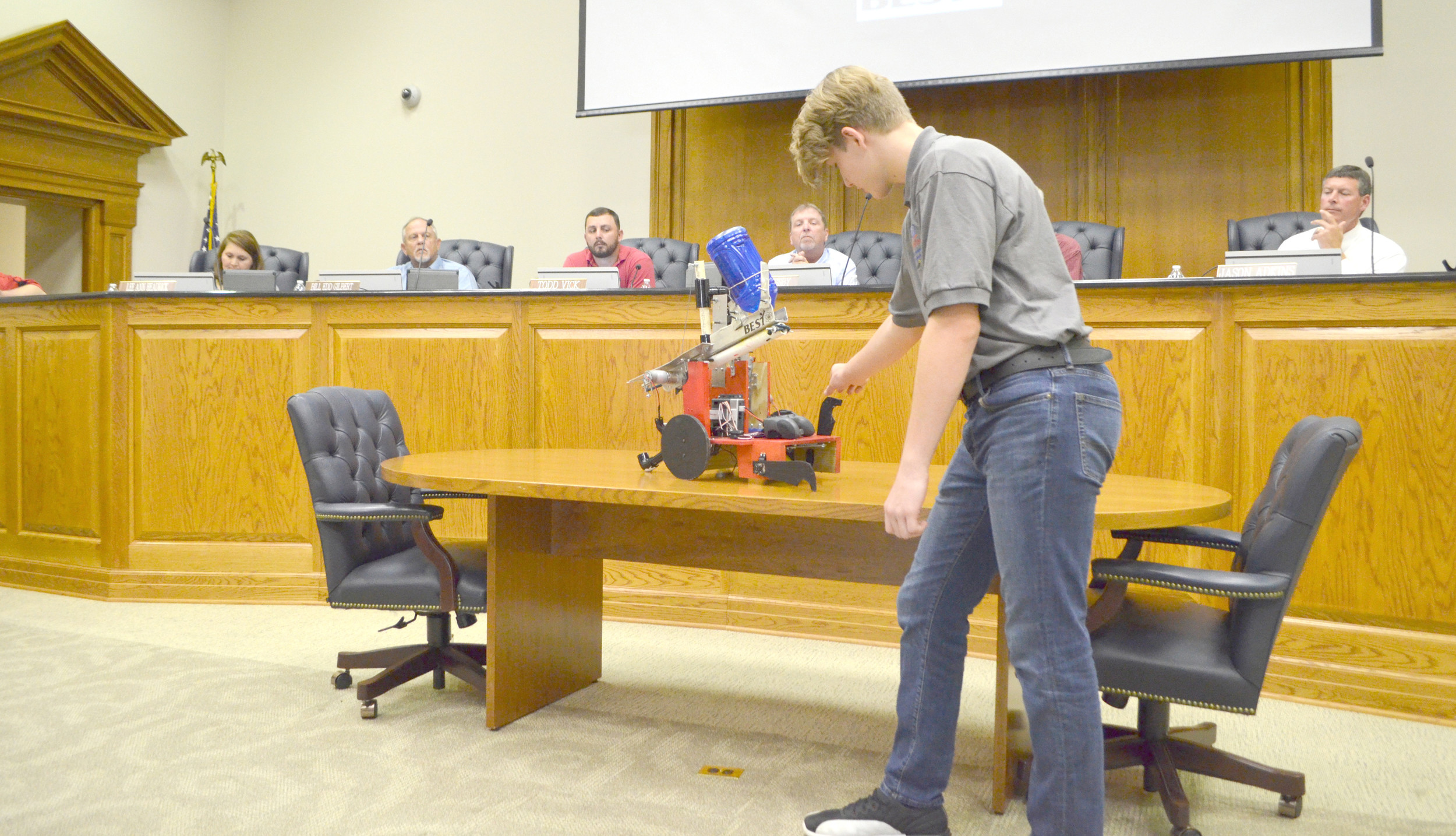 Pictured is student Micah Parsons showing Walker County Board of Education members the Blue Devil Robotics Team robot. Daily Mountain Eagle - Nicole Smith