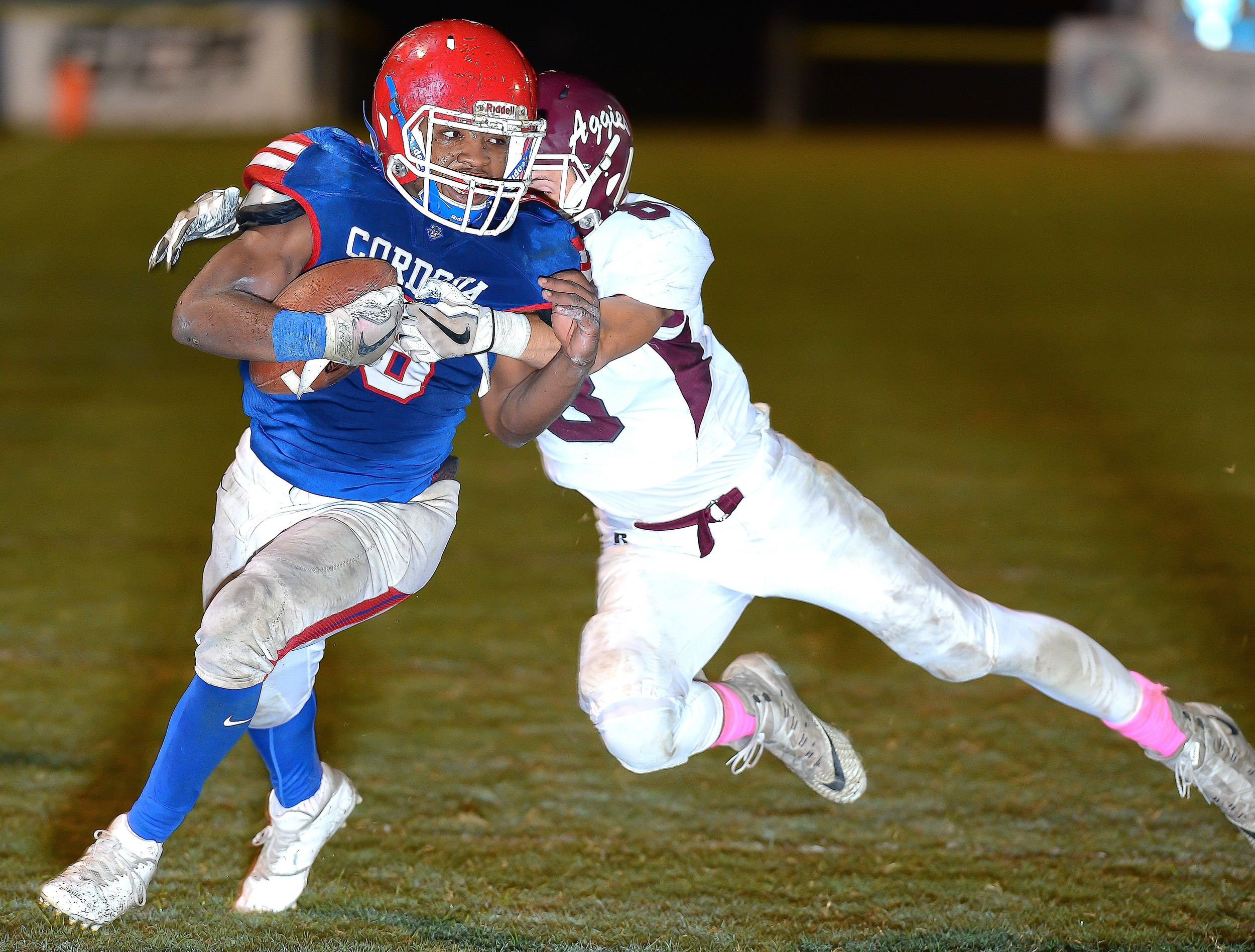 Cordova's Javion Hill battles a Hamilton defender Friday night. Hill picked up 153 yards and two touchdowns in the Blue Devils' 34-28 win.