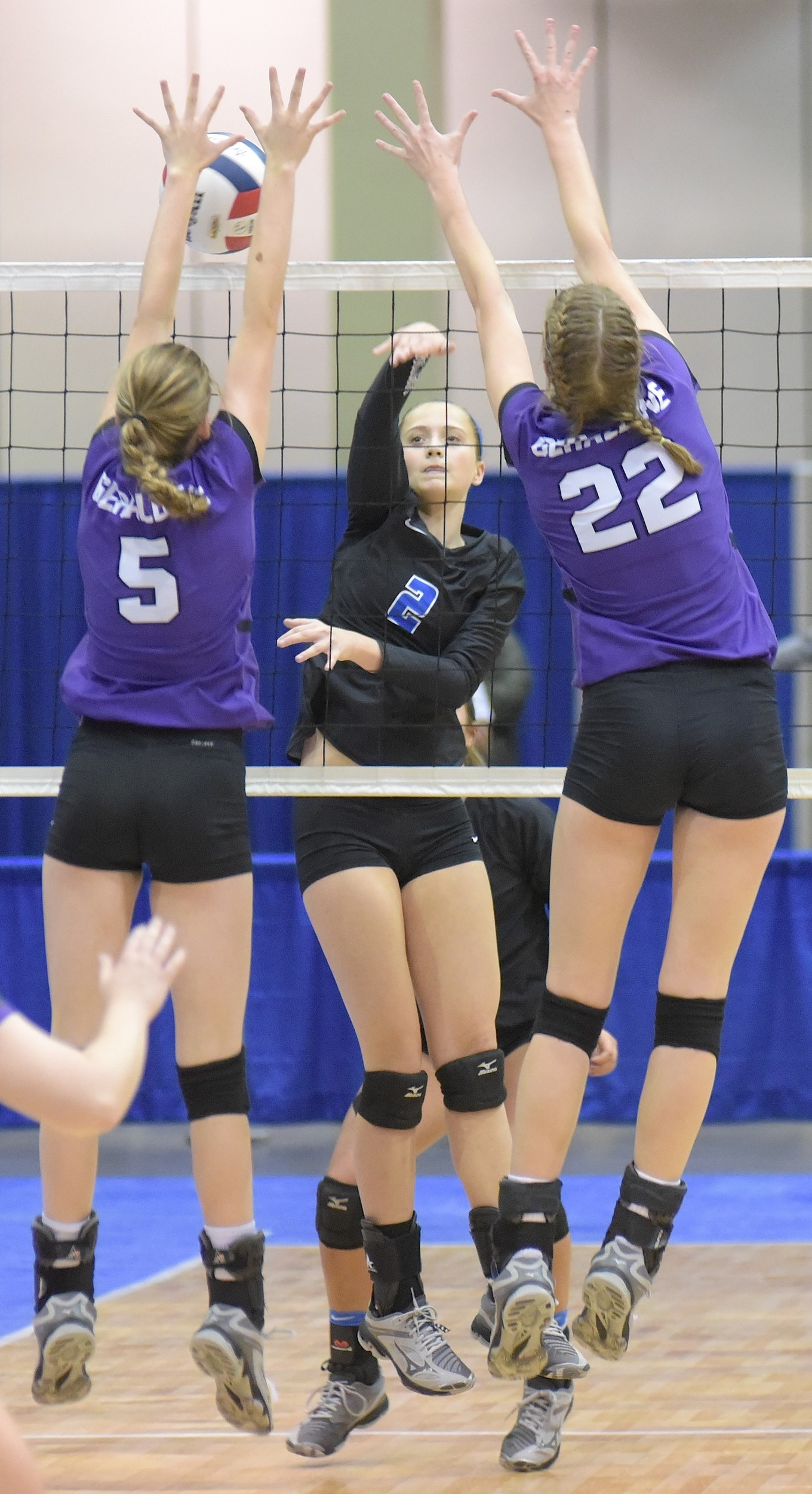 Carbon Hill's Grayson Evans (2) hits the ball over the net as Geraldine's Haven Hall (5) and Karlee Hale (22) defend during their match at the North Super Regional Tournament in Huntsville on Saturday.