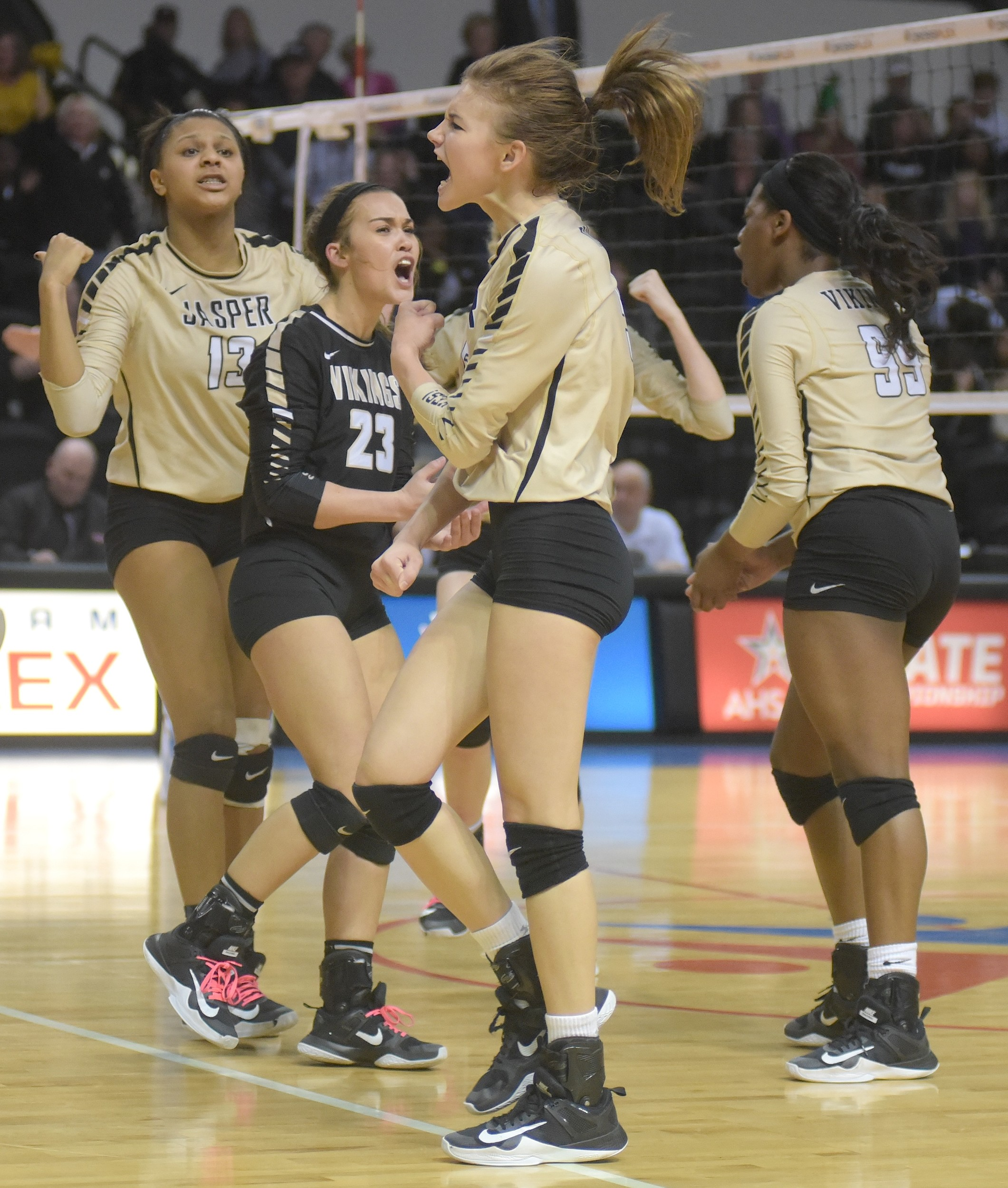 Jasper player celebrate winning a point in the fourth set of the Class 6A state championship match against Pelham.