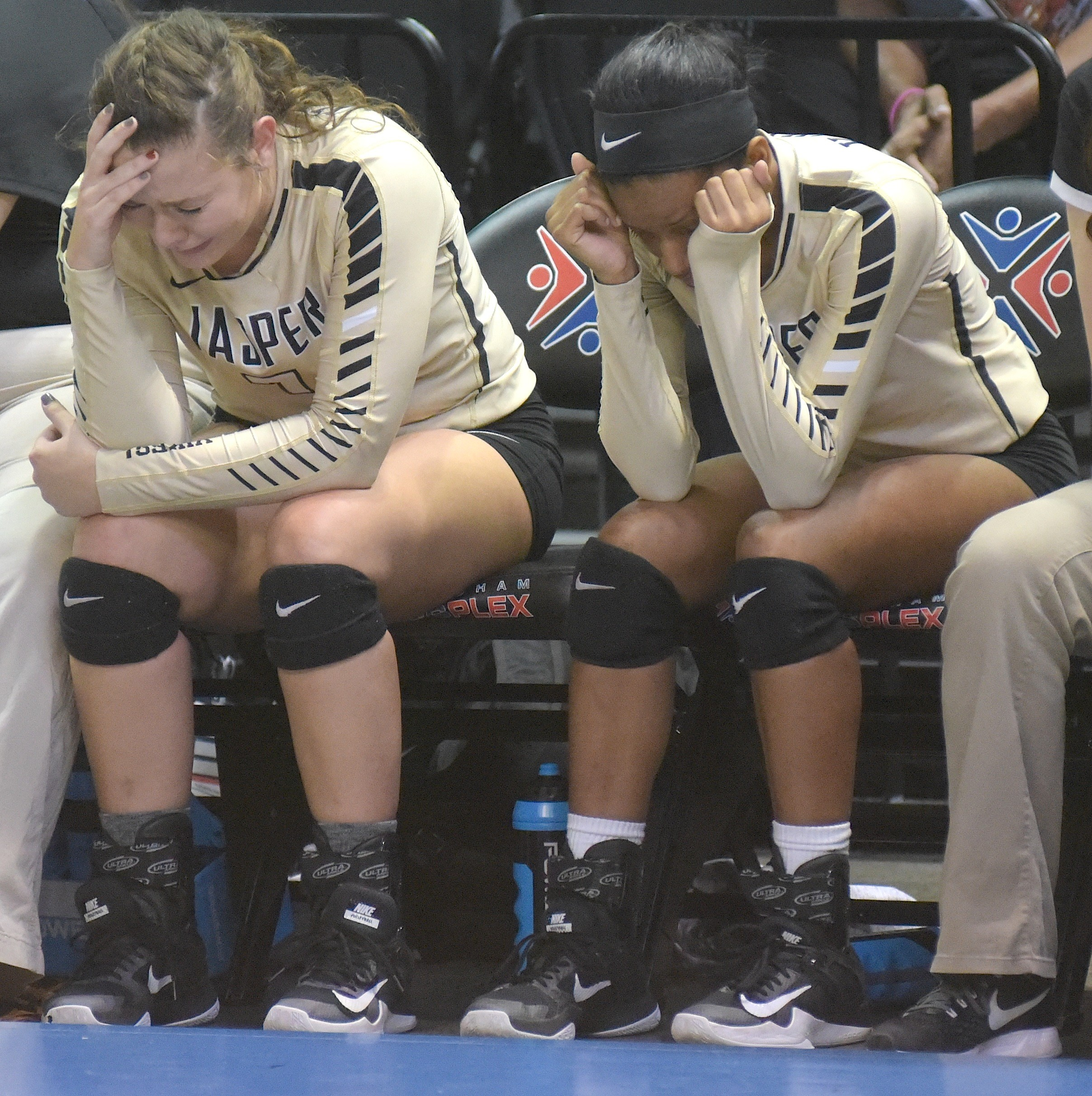 Jasper's Khloe Kimbrell, left, and Kelsey Shelton, right, react following the Vikings' championship game loss to Pelham in Birmingham Thursday.