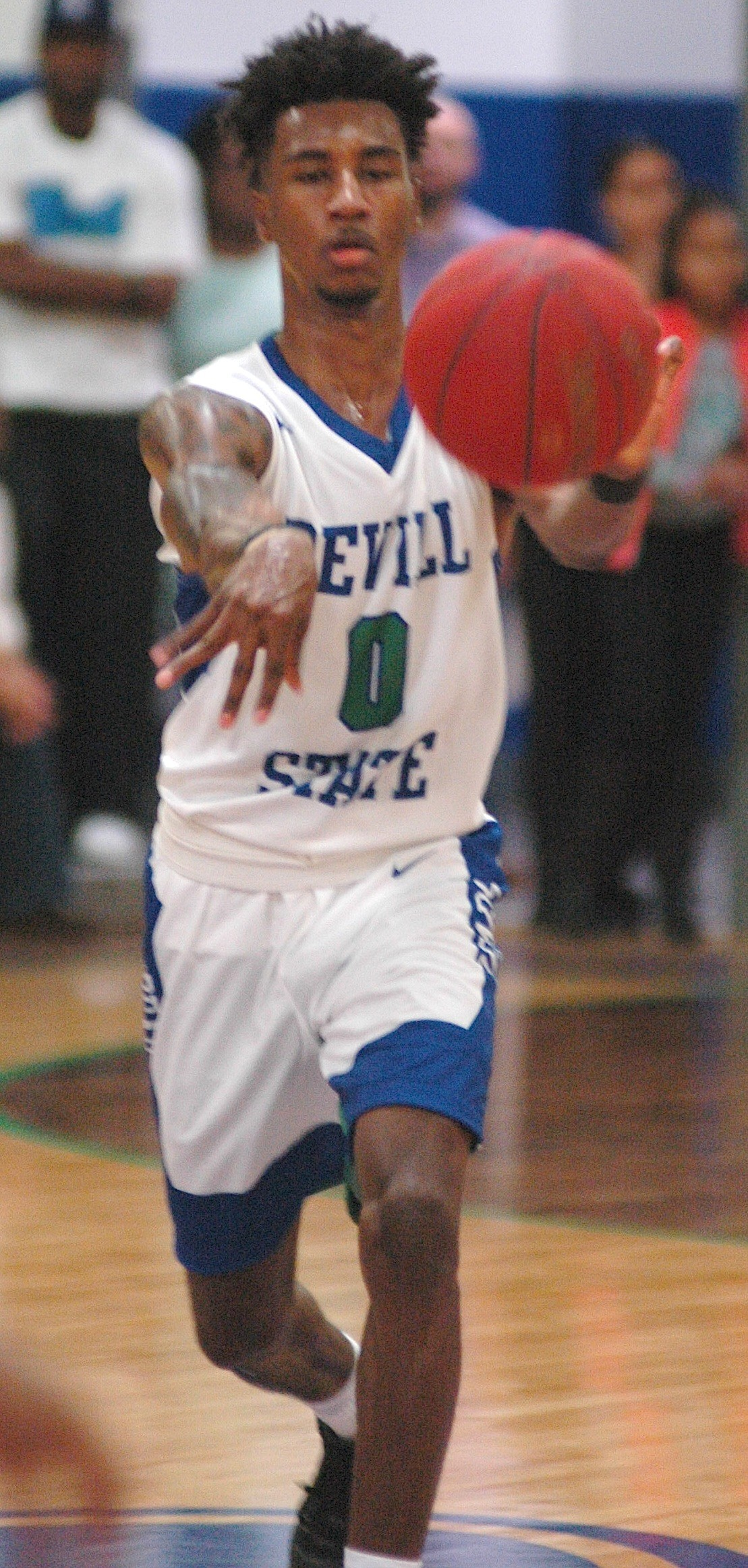 Bevill State's Earnest Medlock passes to a teammate during the Bears' season opener against Coastal Alabama South at Glen Clem Gymnasium on Thursday. The game was the first for Bevill State since the school shut down the program in 2011. Medlock had 19 points in the 85-74 loss.