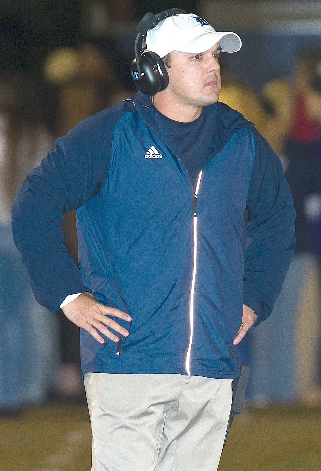 Dora football coach Bart Lockhart looks on during the Bulldogs' win over Good Hope this season. Dora hosts Deshler in the first round of the playoffs tonight.