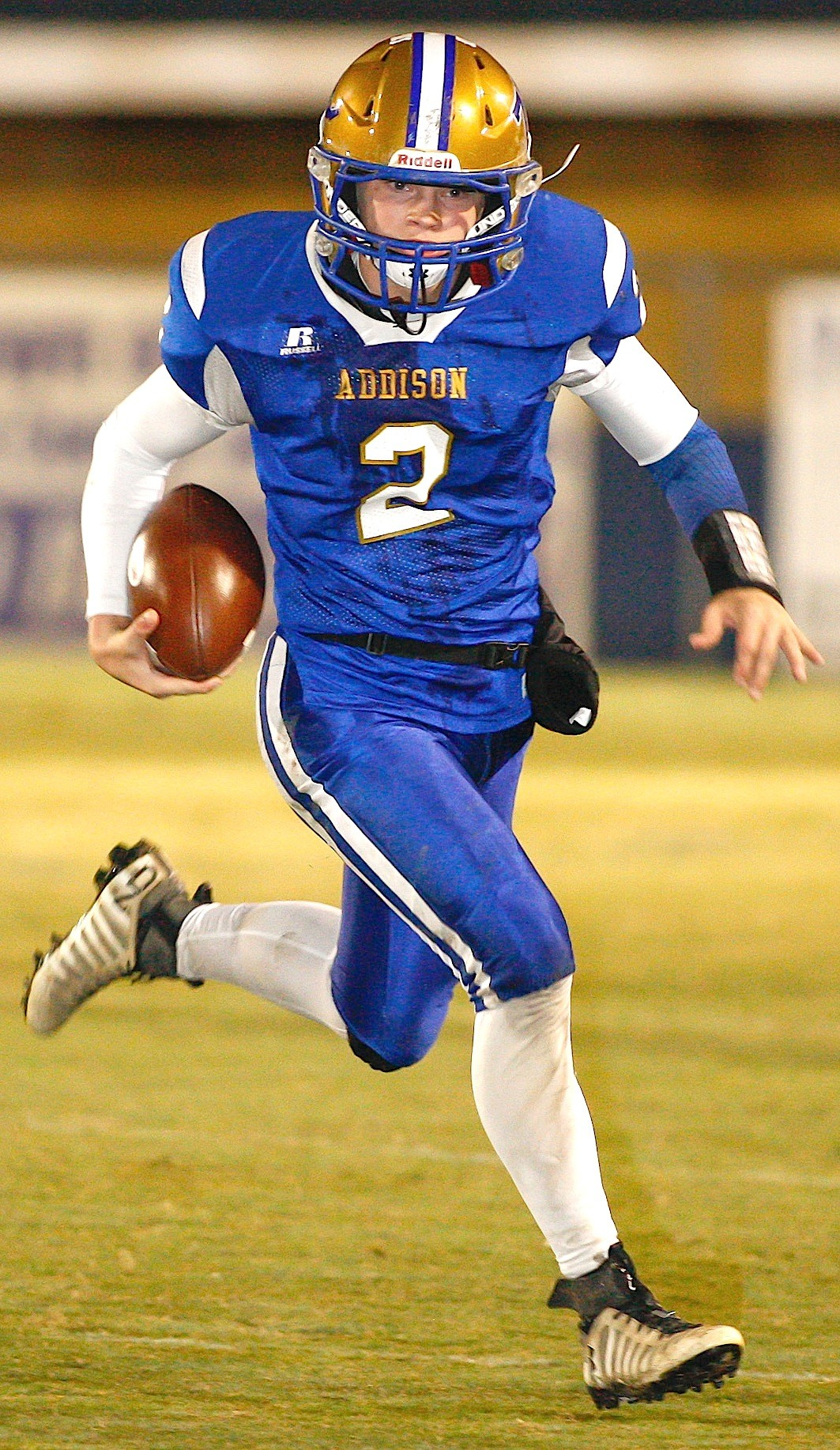 Addison's Zayne Guthrie runs against Hubbertville Thursday night. Guthrie threw two touchdown passes and rushed for a score.