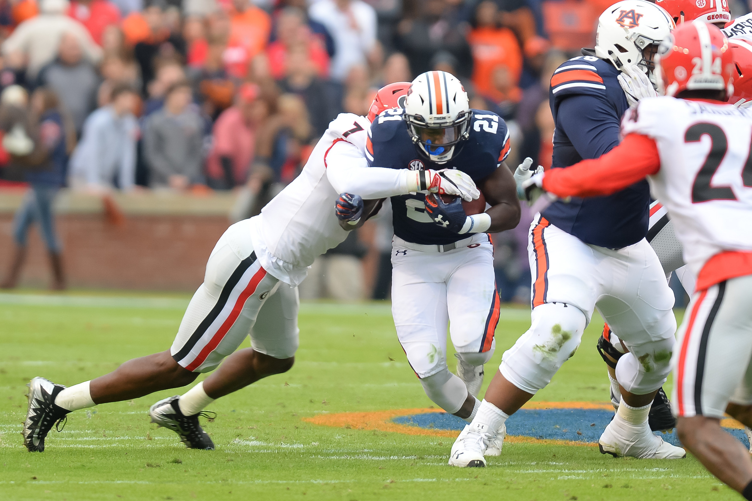 Georgia Bulldogs linebacker Lorenzo Carter (7) tackles Auburn Tigers running back Kerryon Johnson (21) during the first half of Saturday's game, at Jordan-Hare Stadium.