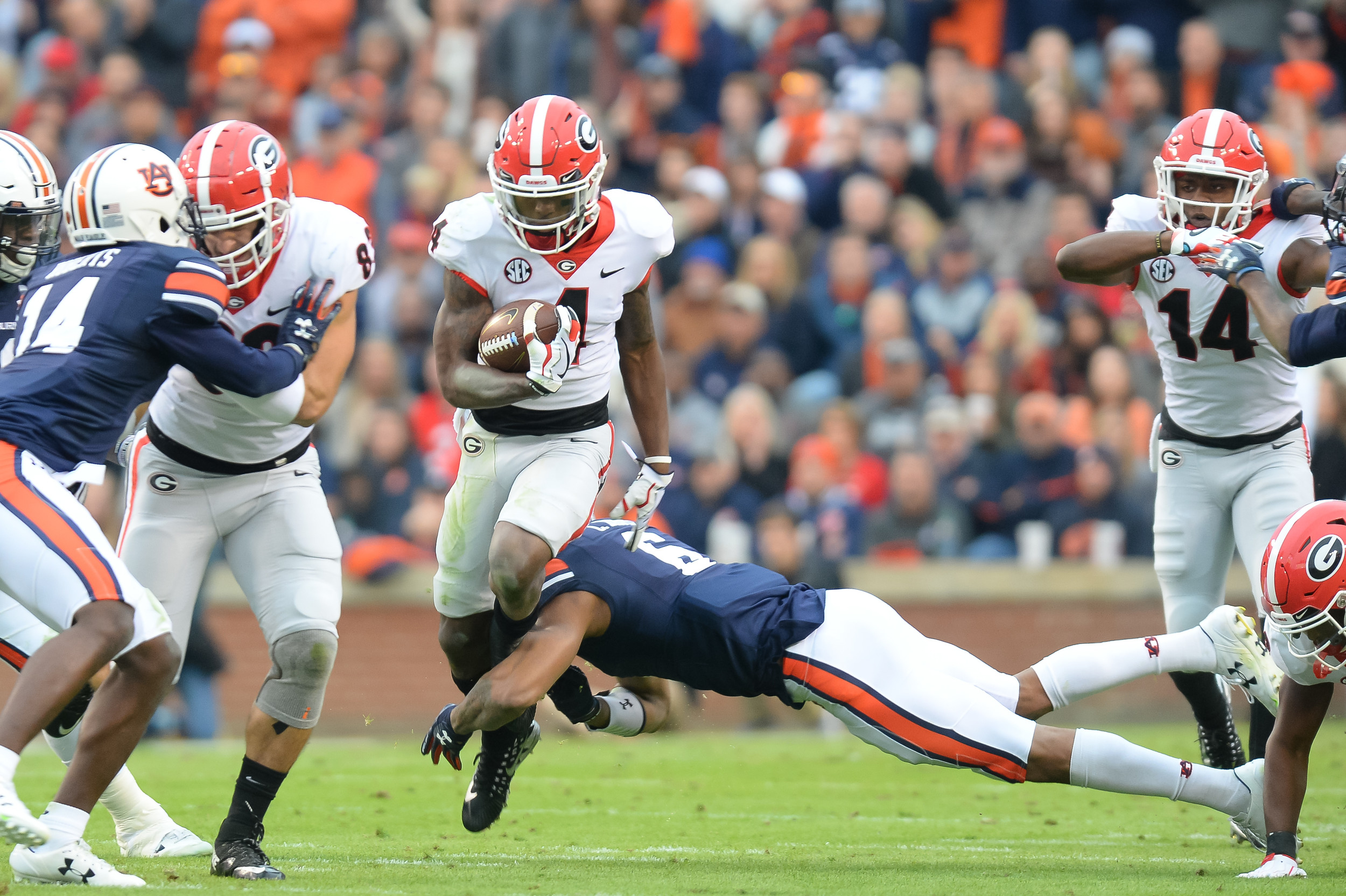Georgia Bulldogs wide receiver Mecole Hardman (4) is tackled by Auburn Tigers defensive back Carlton Davis (6) during the first half of Saturday's game, at Jordan-Hare Stadium.