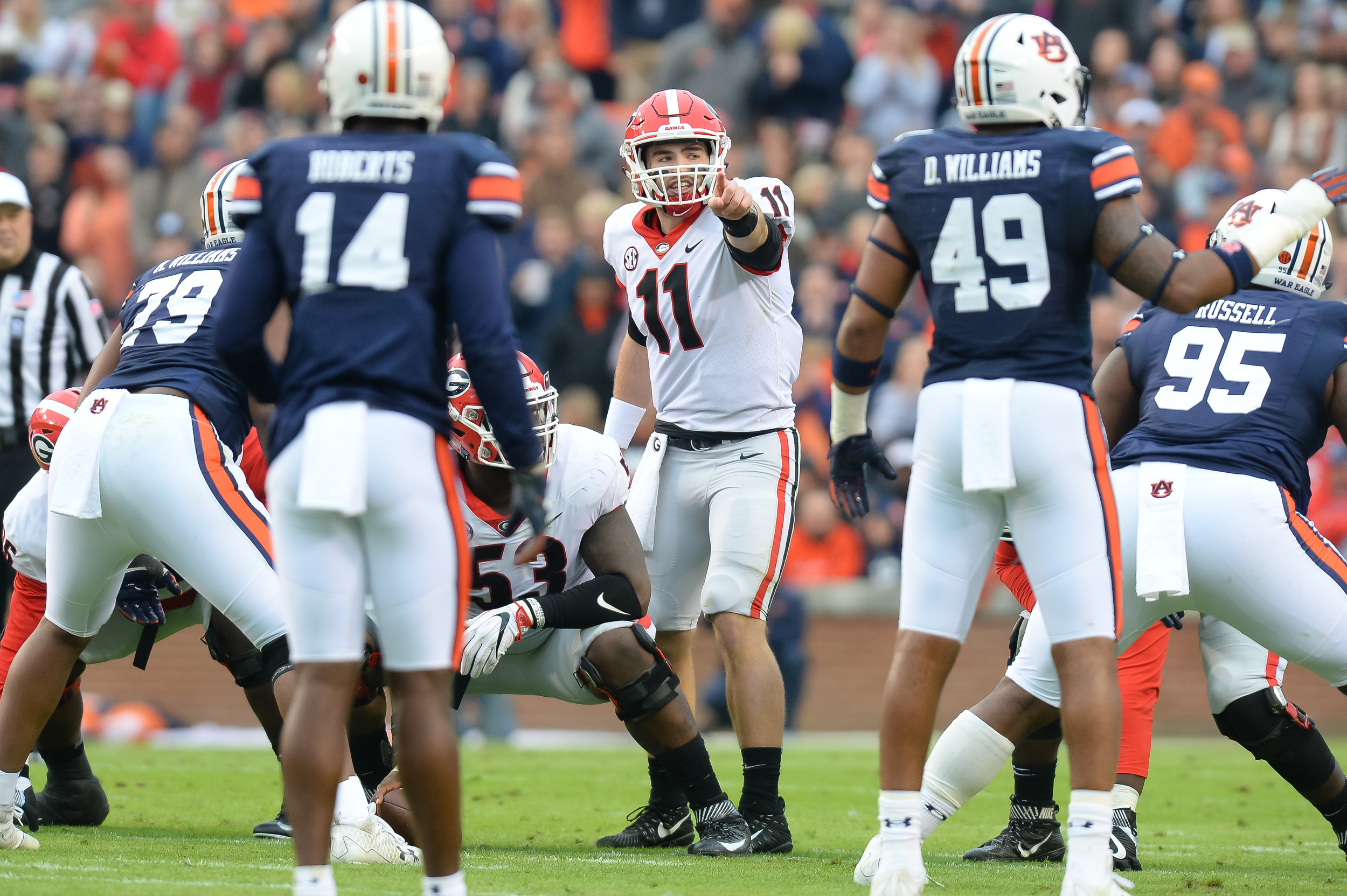 Georgia Bulldogs quarterback Jake Fromm (11) directs the offense during the first half of Saturday's game, at Jordan-Hare Stadium.