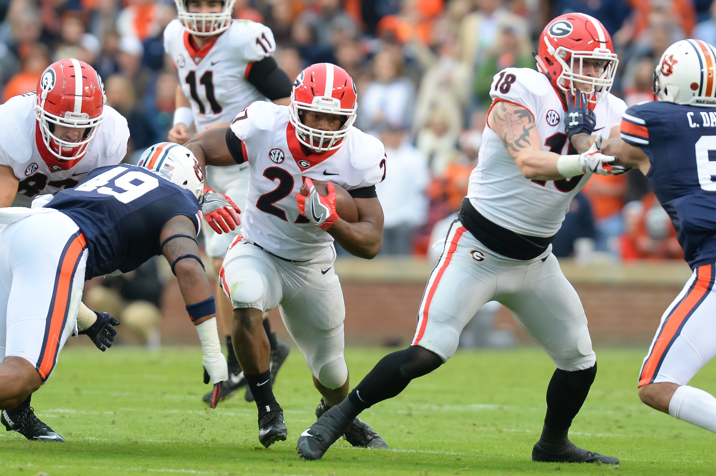 Georgia Bulldogs running back Nick Chubb (27) tries to get past Auburn Tigers linebacker Darrell Williams (49) during the first half of Saturday's game, at Jordan-Hare Stadium.