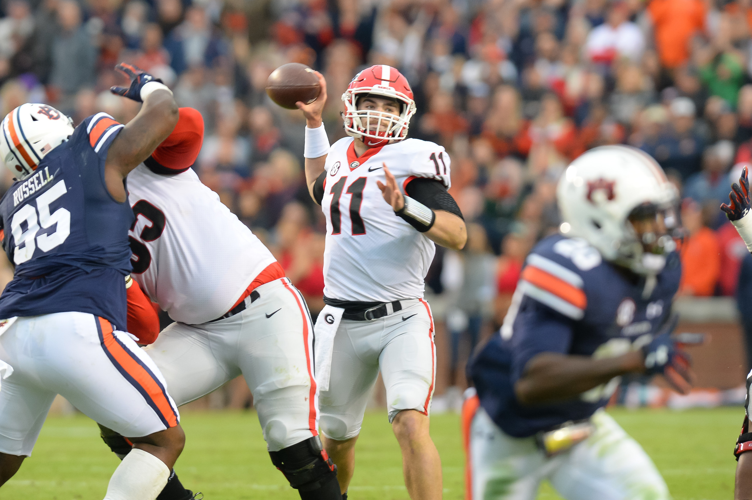 Georgia Bulldogs quarterback Jake Fromm (11) throws during the first half of Saturday's game, at Jordan-Hare Stadium.