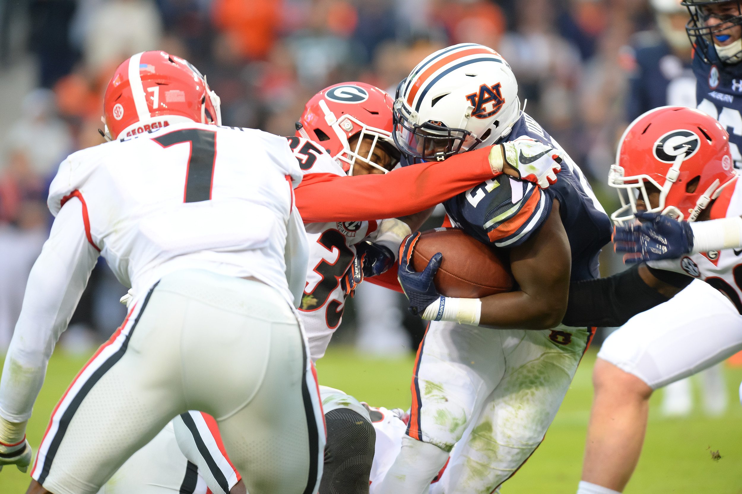 Auburn Tigers running back Kerryon Johnson (21) is tackled by Georgia Bulldogs defensive back Aaron Davis (35) the first half of Saturday's game, at Jordan-Hare Stadium.