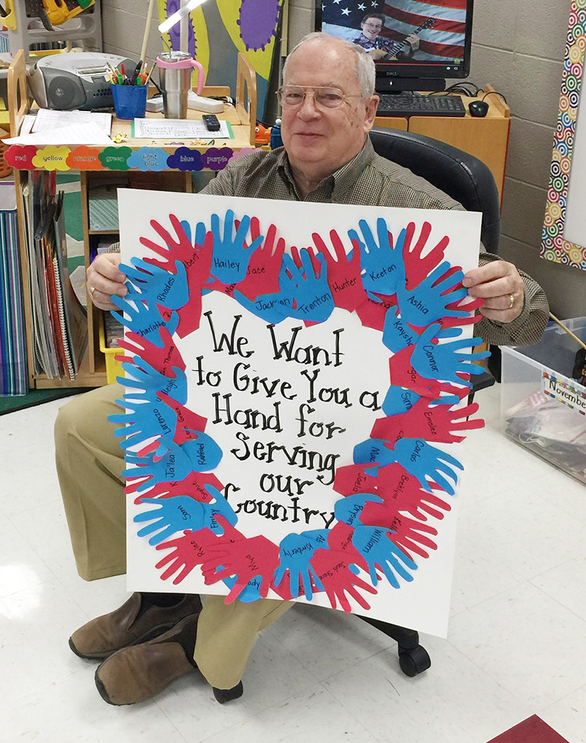 Keith Lewis, a former priest at Saint Mary's Episcopal Church in Jasper, was honored  at T.R. Simmons Elementary School on Wednesday.