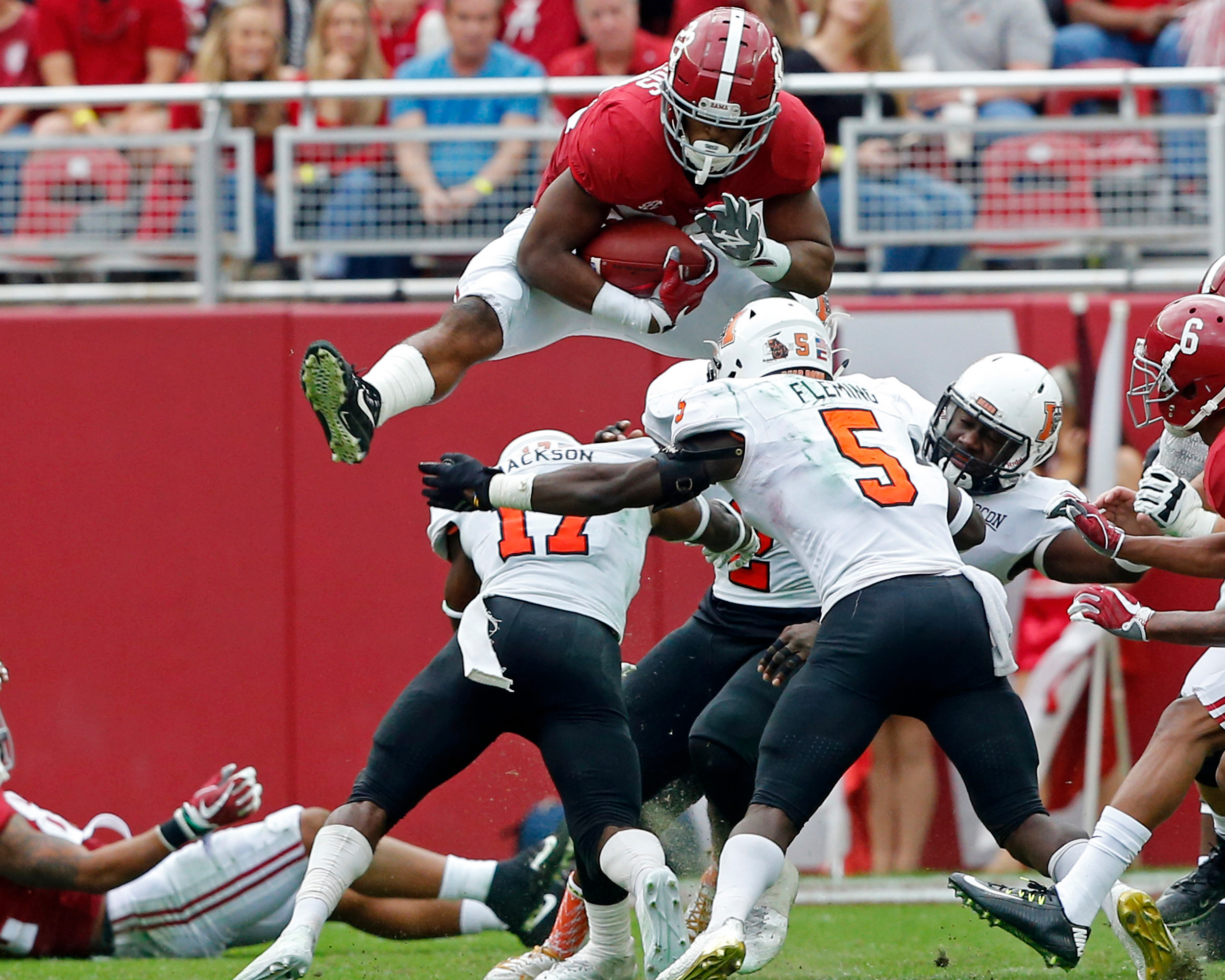 Alabama Crimson Tide running back Najee Harris (22) leaps for a 1st down during the 1st half of the game between the Mercer Bears and the University of Alabama Crimson Tide at Bryant-Denny Stadium in Tuscaloosa, Al on 11/18/2017.