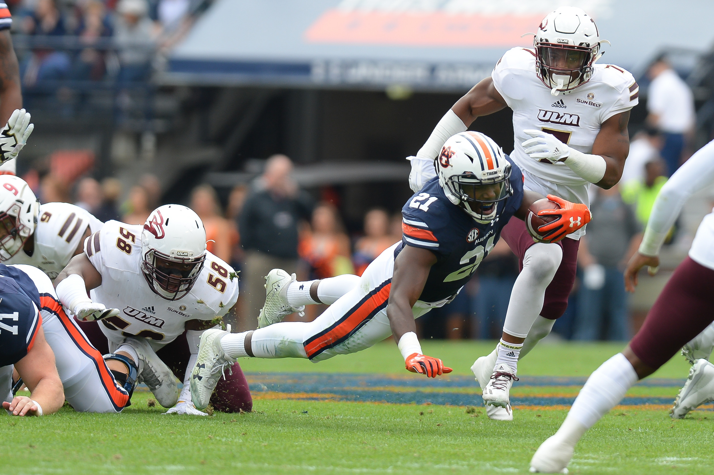 Auburn Tigers running back Kerryon Johnson (21) dives for yardage during the first half of Saturday's game, at Jordan-Hare Stadium.