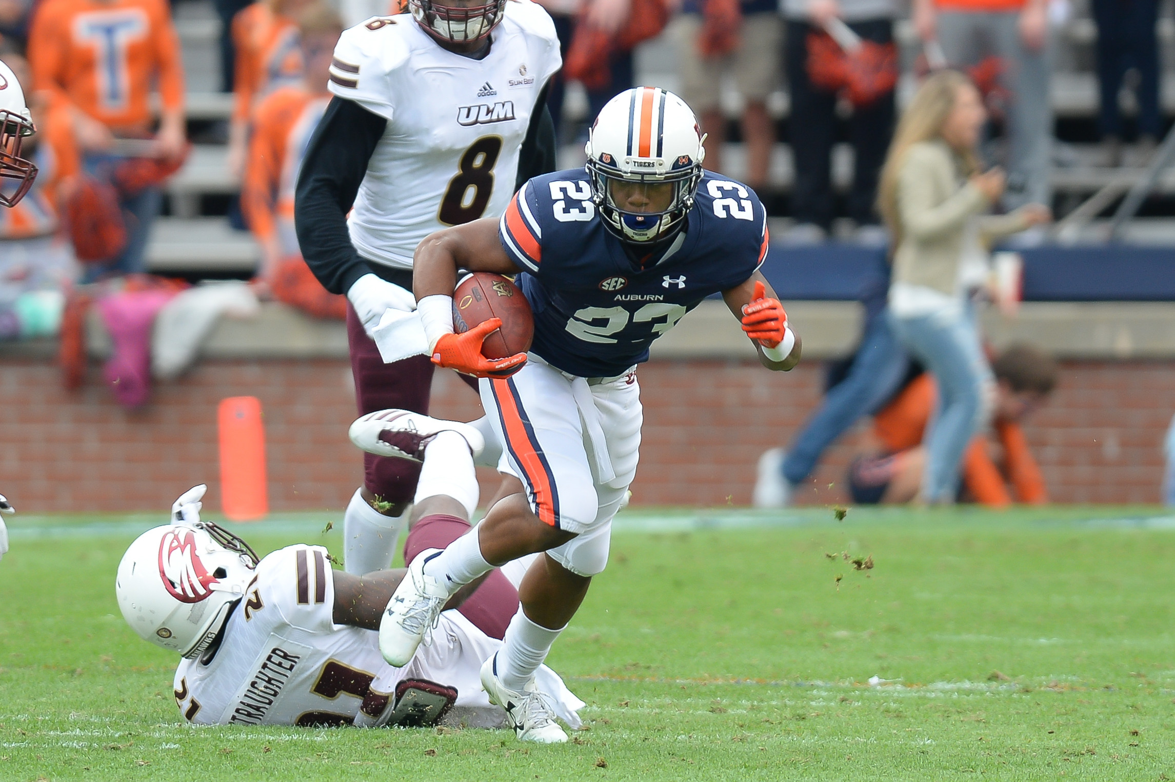 Louisiana Monroe Warhawks cornerback Corey Straughter (21) can make the tackle on Auburn Tigers wide receiver Ryan Davis (23) during the first half of Saturday's game, at Jordan-Hare Stadium.