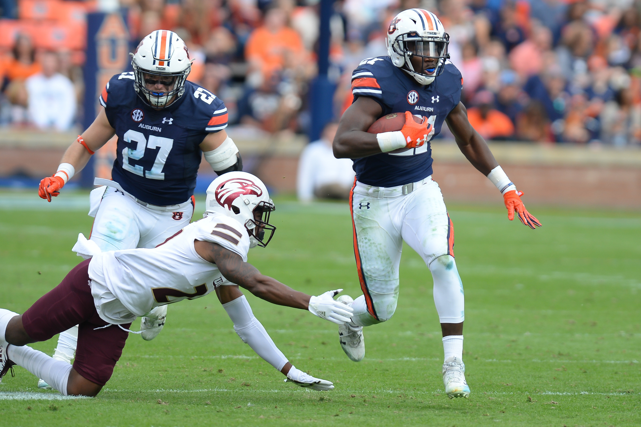 Auburn Tigers running back Kerryon Johnson (21) runs during the first half of Saturday's game, at Jordan-Hare Stadium.