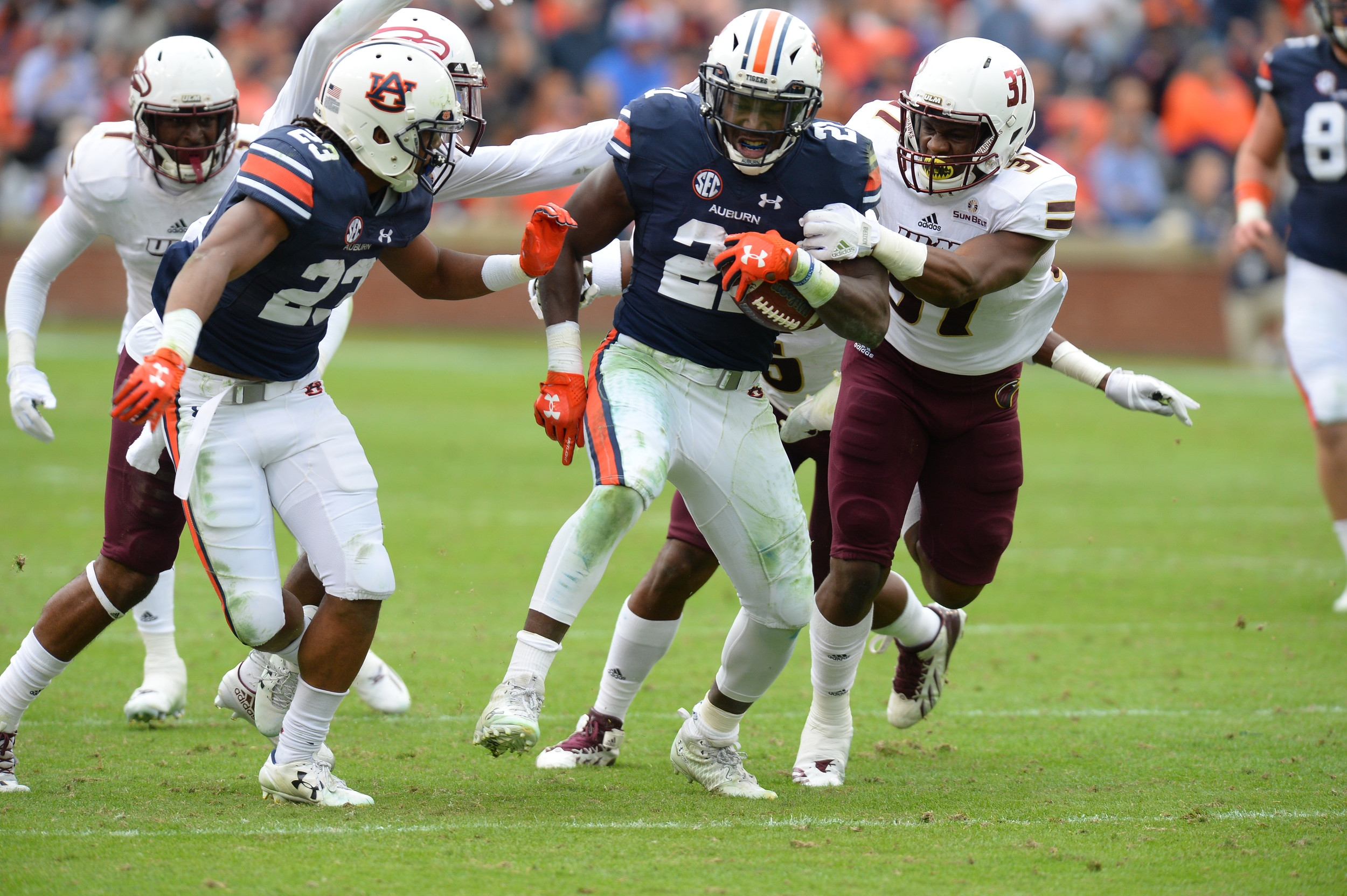 Auburn Tigers running back Kerryon Johnson (21) is tackled by Louisiana Monroe Warhawks safety Traveion Webster (37) during the second half of Saturday's game, at Jordan-Hare Stadium.