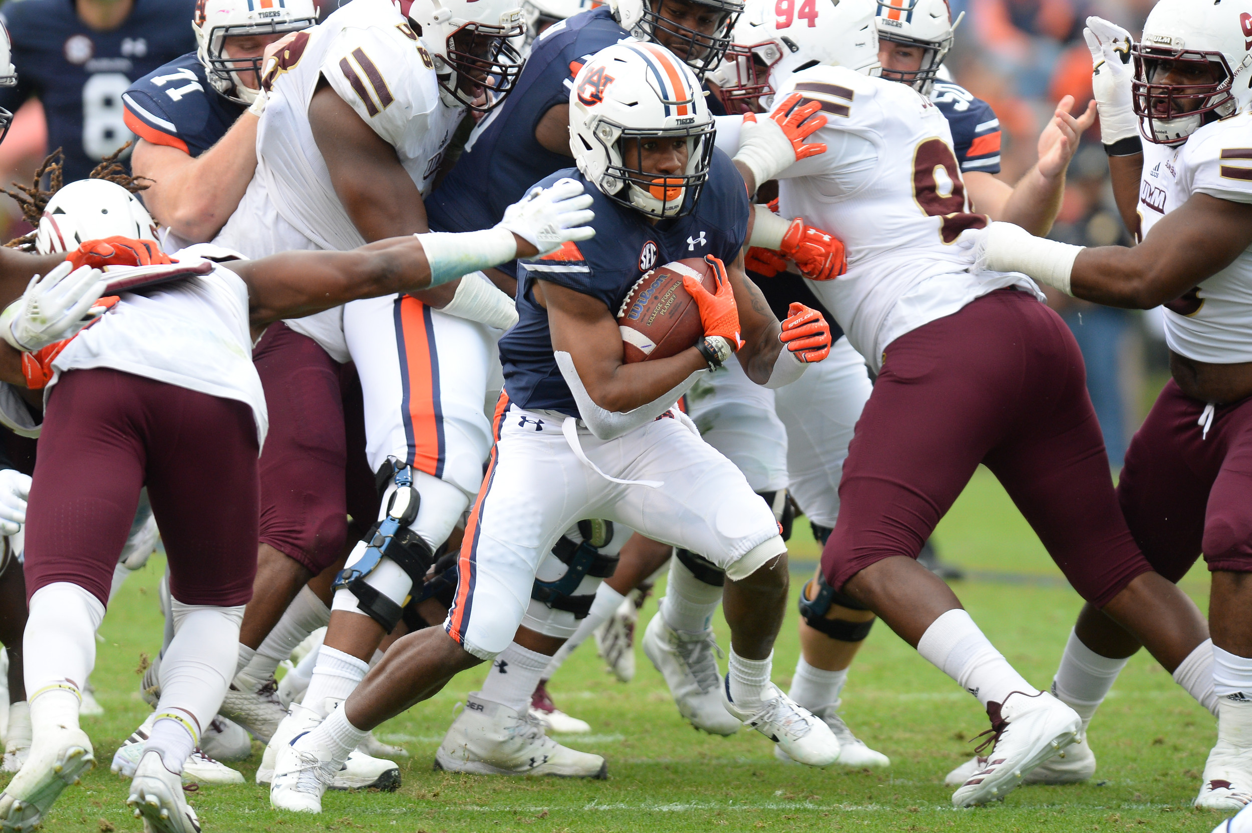 Auburn Tigers running back Kam Martin (9) looks for yardage during the second half of Saturday's game, at Jordan-Hare Stadium.