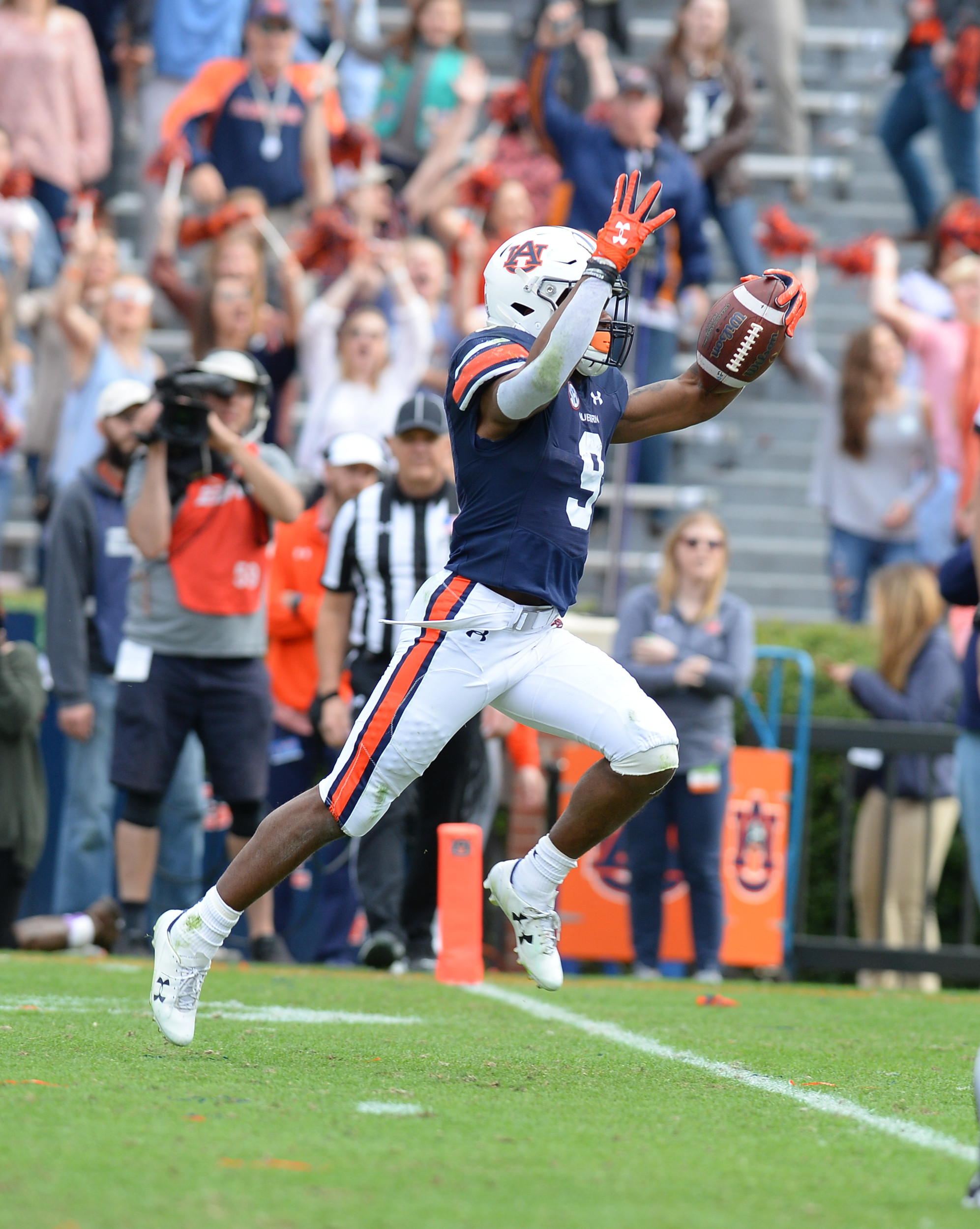 Auburn Tigers running back Kam Martin (9) scores on a 42 yard reception during the second half of Saturday's game, at Jordan-Hare Stadium.