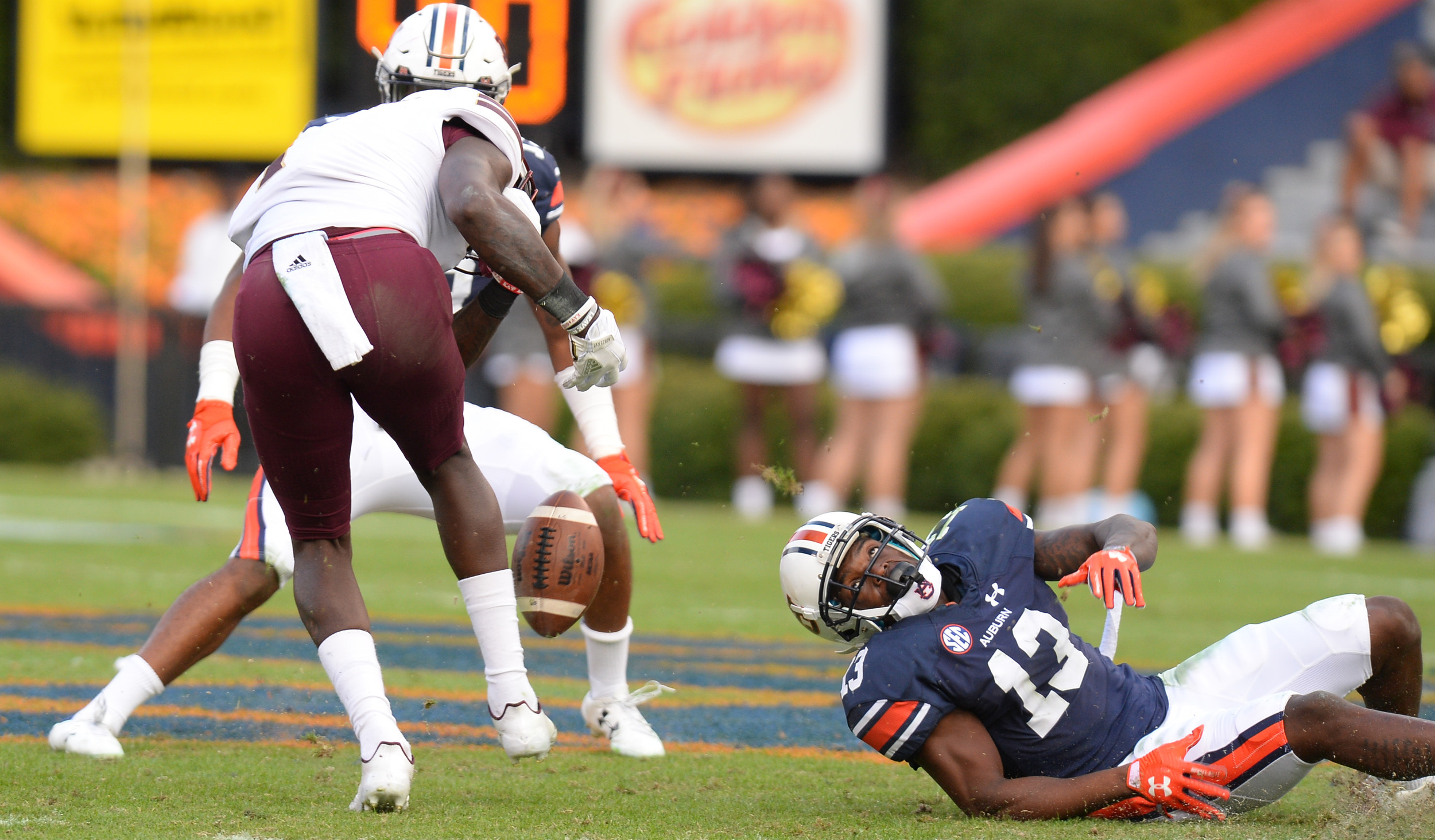 Louisiana Monroe Warhawks wide receiver Brian Williams (1) is stripped of the football by Auburn Tigers defensive back Javaris Davis (13) during the second half of Saturday's game, at Jordan-Hare Stadium.