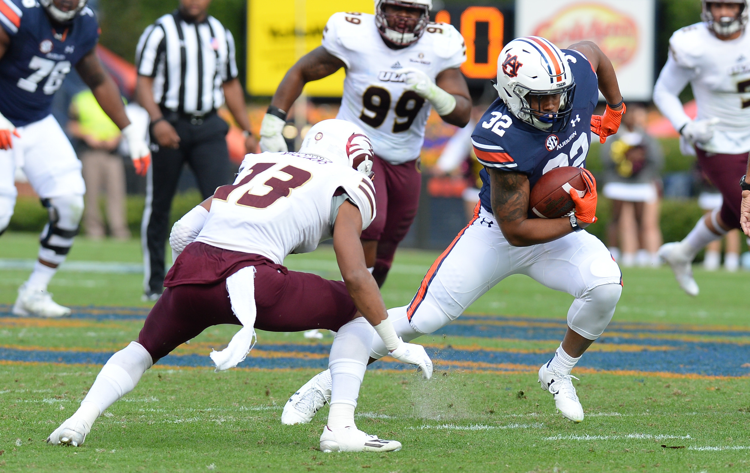 Louisiana Monroe Warhawks cornerback Rhoy Williams (13) looks to tackle Auburn Tigers running back Malik Miller (32) during the second half of Saturday's game, at Jordan-Hare Stadium.