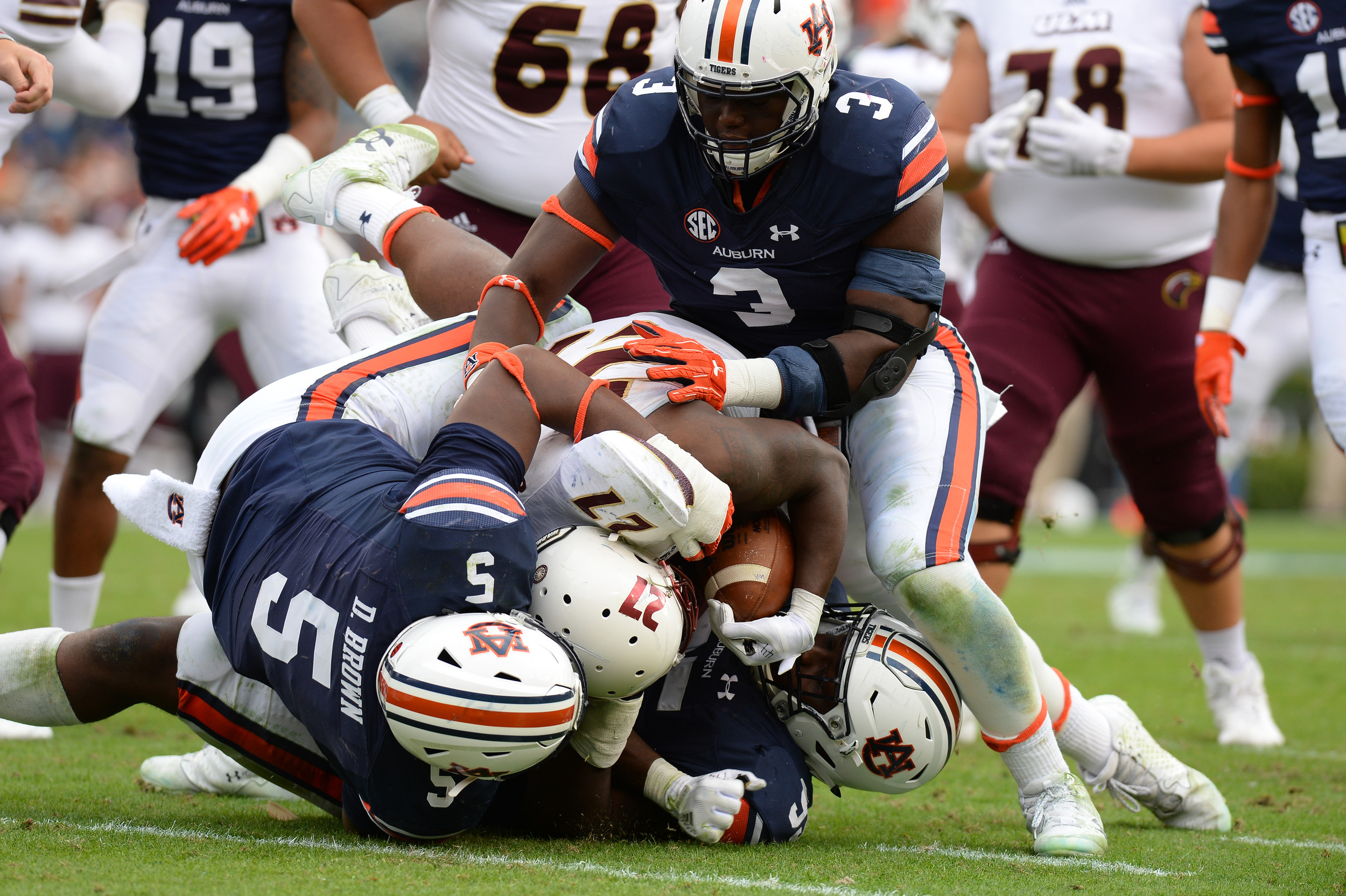 Louisiana Monroe Warhawks running back Derrick Gore (27) is stopped by Auburn Tigers defensive linemen Derrick Brown (5), Dontavius Russell (95) and Marlon Davidson (3) during the second half of Saturday's game, at Jordan-Hare Stadium.