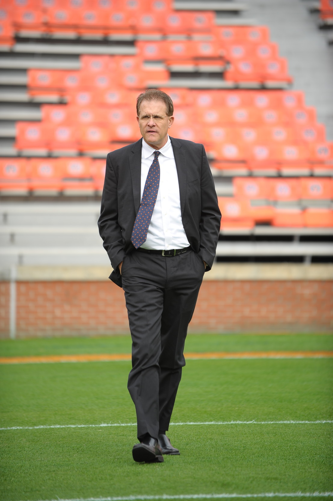 Auburn Tigers head coach Gus Malzahn walks the field prior to Saturday's game, at Jordan-Hare Stadium.