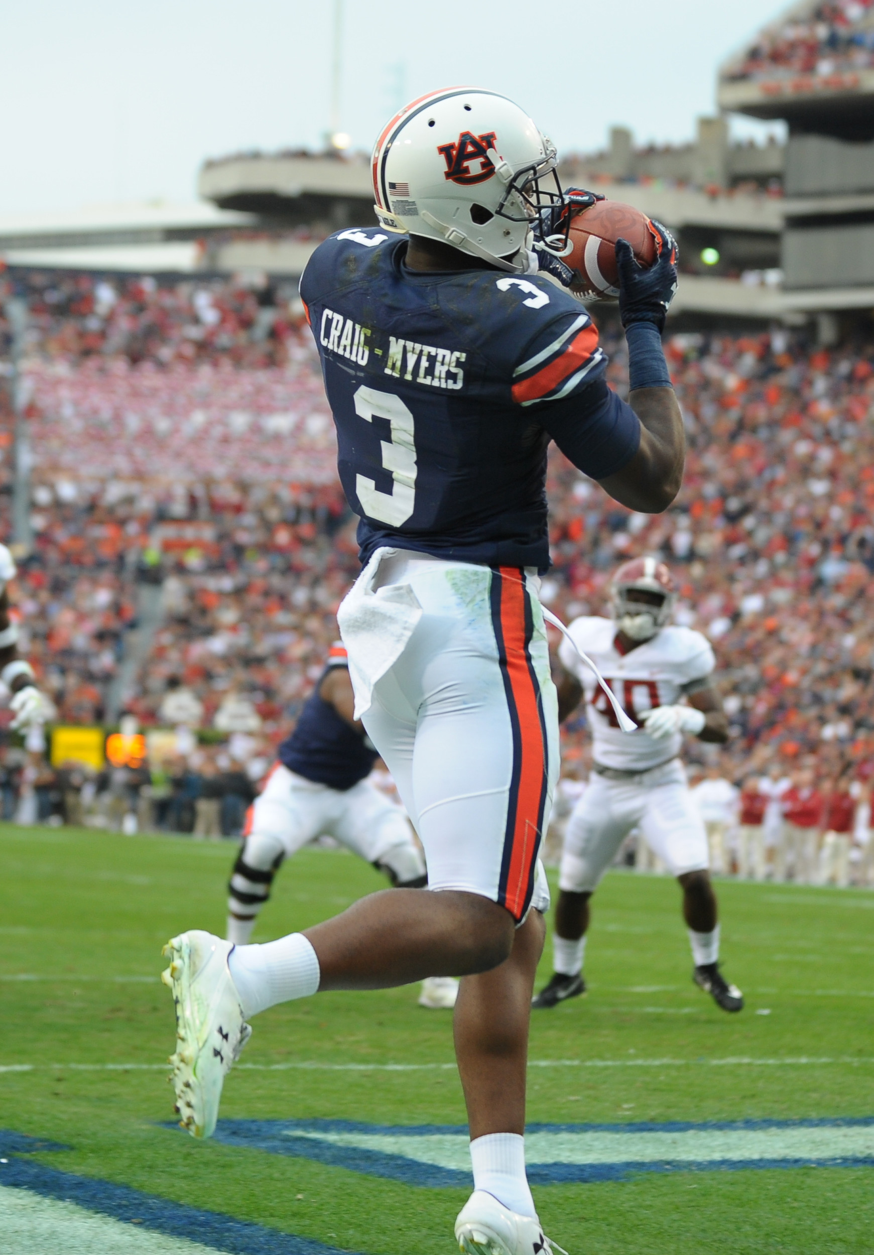 Auburn Tigers wide receiver Nate Craig-Myers (3)catches a touchdown pass from running back Kerryon Johnson during the first half of Saturday's game, at Jordan-Hare Stadium.