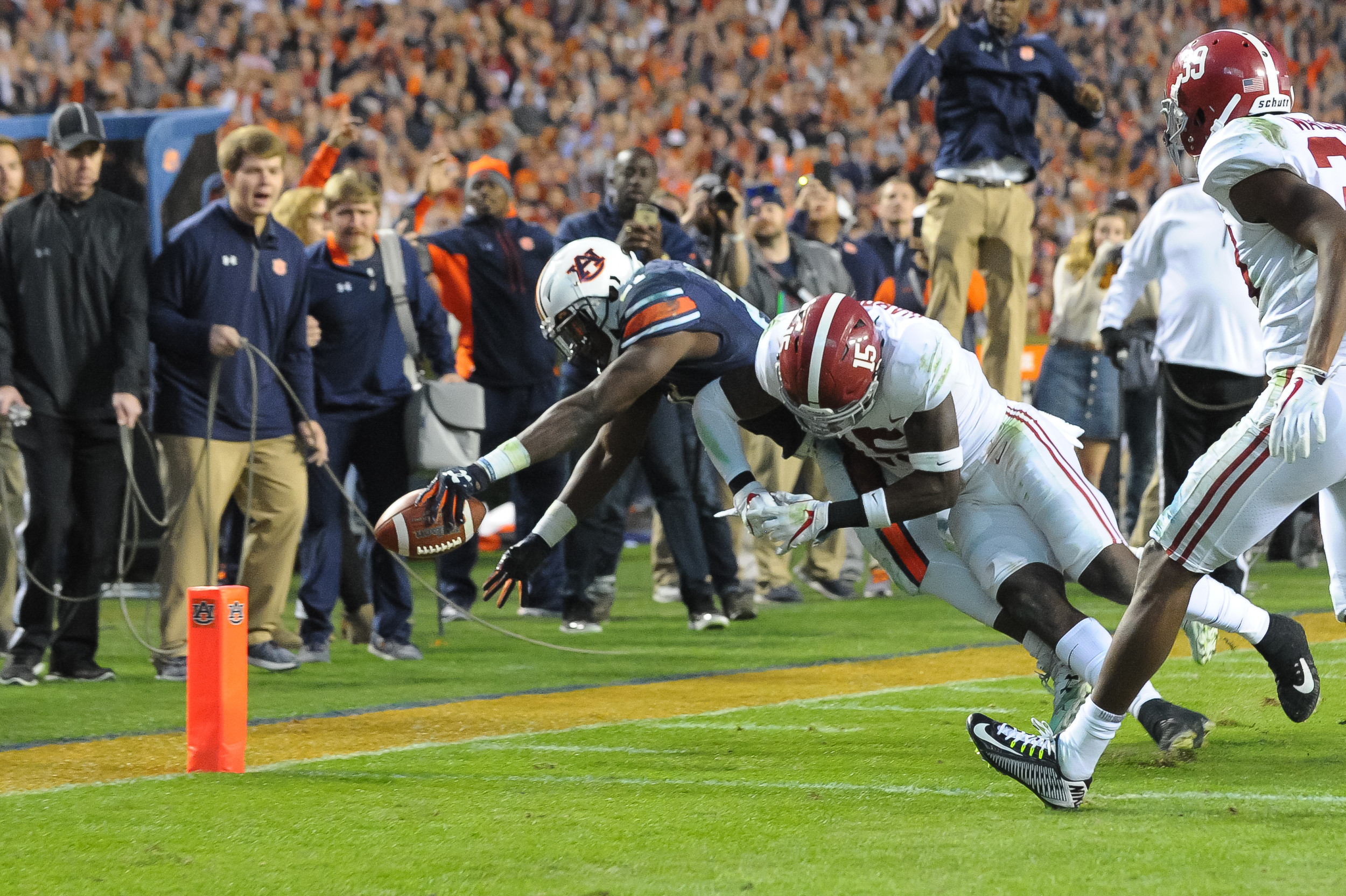 Auburn Tigers running back Kerryon Johnson (21) is knocked out of bounds short of the goal line by Alabama Crimson Tide defensive back Ronnie Harrison (15) during the second half of Saturday's game, at Jordan-Hare Stadium.
