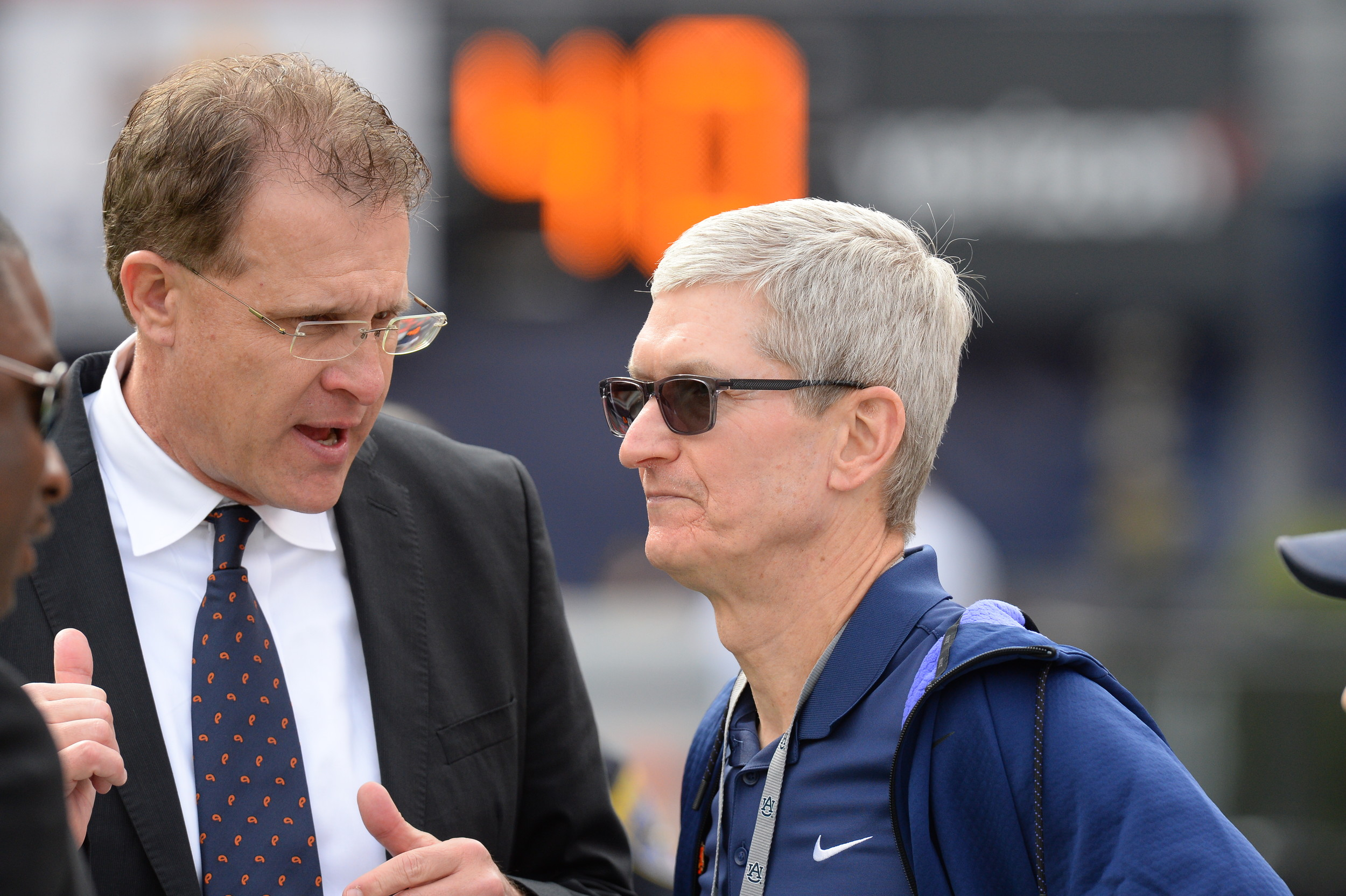 Auburn Tigers head coach Guz Malzahn and Apple's Tim Cook talk prior to Saturday's game, at Jordan-Hare Stadium.