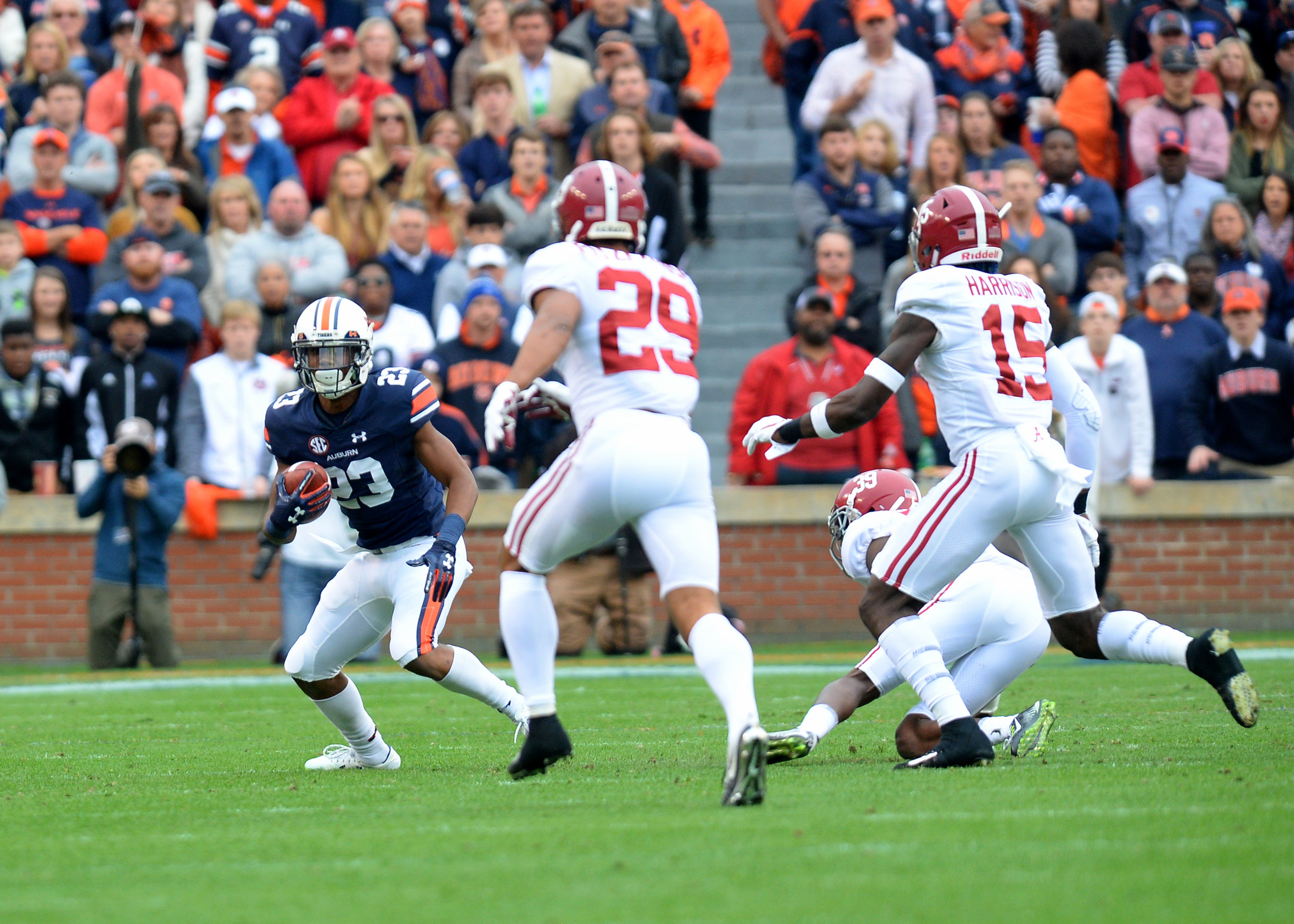 Auburn Tigers wide receiver Ryan Davis (23) on a carry in  the first half of the NCAA football game between the Alabama Crimson Tide and the Auburn Tigers on Nov. 25, 2017, at Jordan-Hare Stadium in Auburn, Ala. (Photo by Jeff Johnsey)