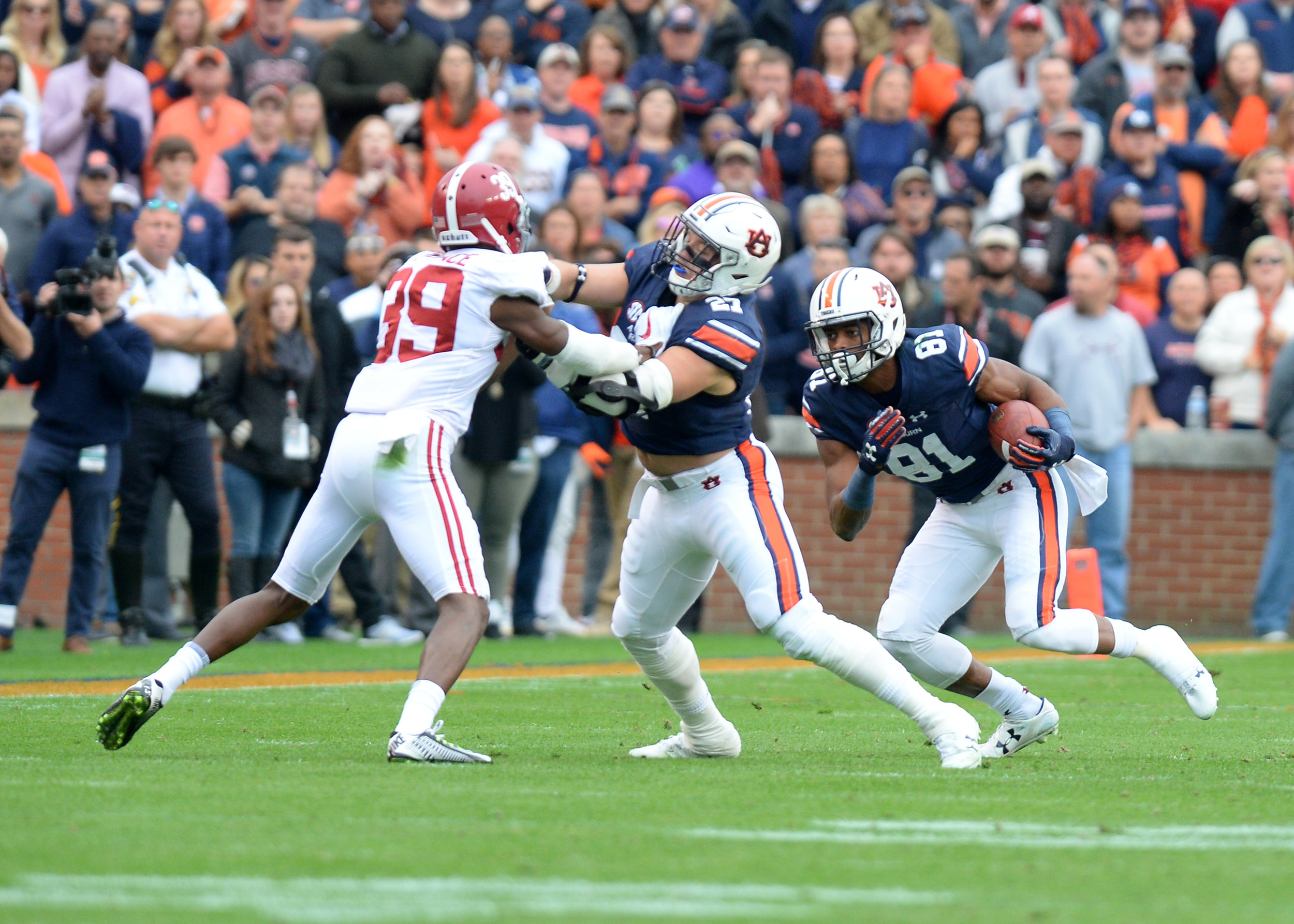 Auburn Tigers wide receiver Darius Slayton (81) gets a block from fullback Chandler Cox (27) in the first half of the NCAA football game between the Alabama Crimson Tide and the Auburn Tigers on Nov. 25, 2017, at Jordan-Hare Stadium in Auburn, Ala. (Photo by Jeff Johnsey)