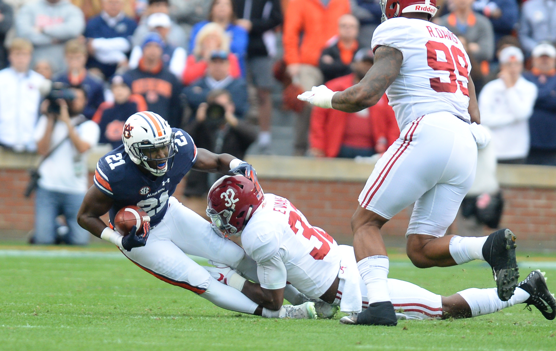 Auburn Tigers running back Kerryon Johnson (21) is tackled by Alabama Crimson Tide linebacker Rashaan Evans (32) during the first half of Saturday's game, at Jordan-Hare Stadium.
