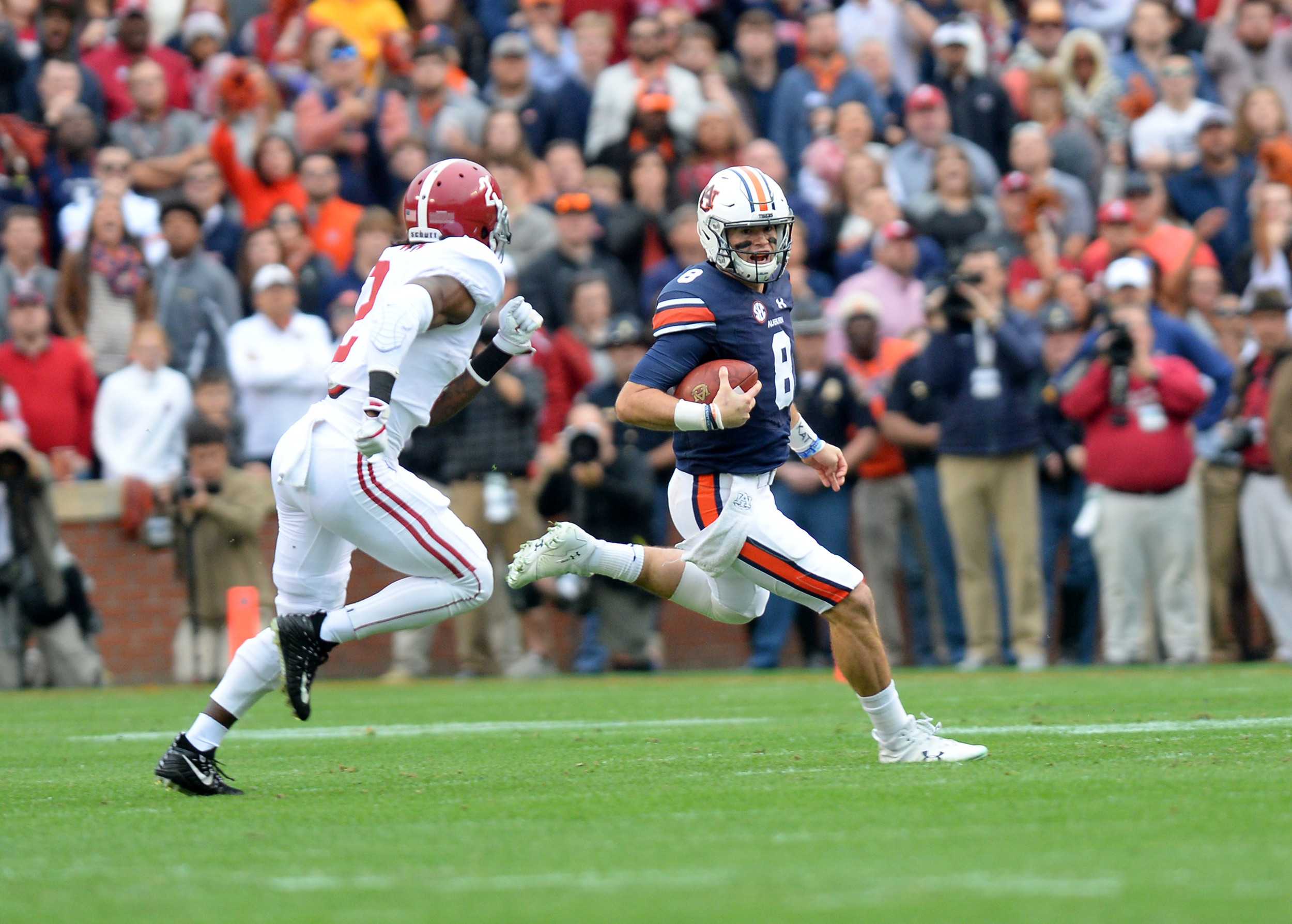 Auburn Tigers quarterback Jarrett Stidham (8) with a keeper in the first half of the NCAA football game between the Alabama Crimson Tide and the Auburn Tigers on Nov. 25, 2017, at Jordan-Hare Stadium in Auburn, Ala. (Photo by Jeff Johnsey)