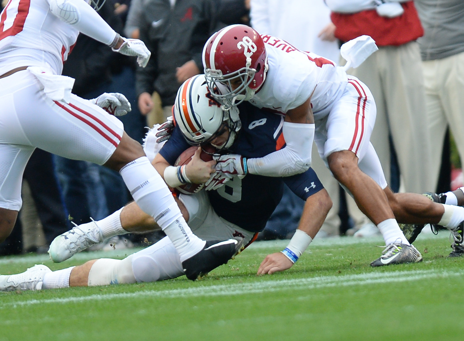 Auburn Tigers quarterback Jarrett Stidham (8) is tackled by Alabama Crimson Tide defensive back Anthony Averett (28) during the first half of Saturday's game, at Jordan-Hare Stadium.