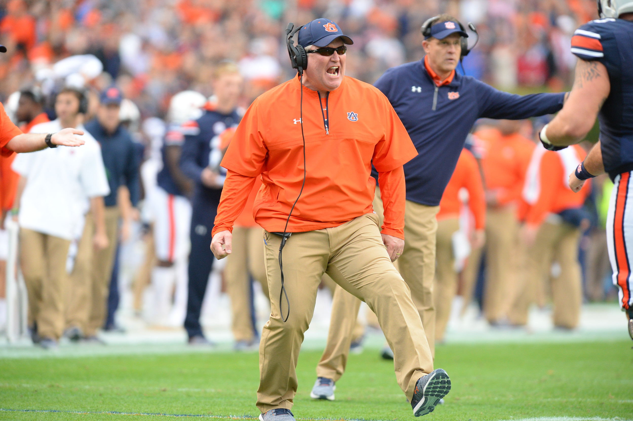 Auburn offensive line coach Herb Hand reacts to an Auburn touchdown during the first half of Saturday's game, at Jordan-Hare Stadium.