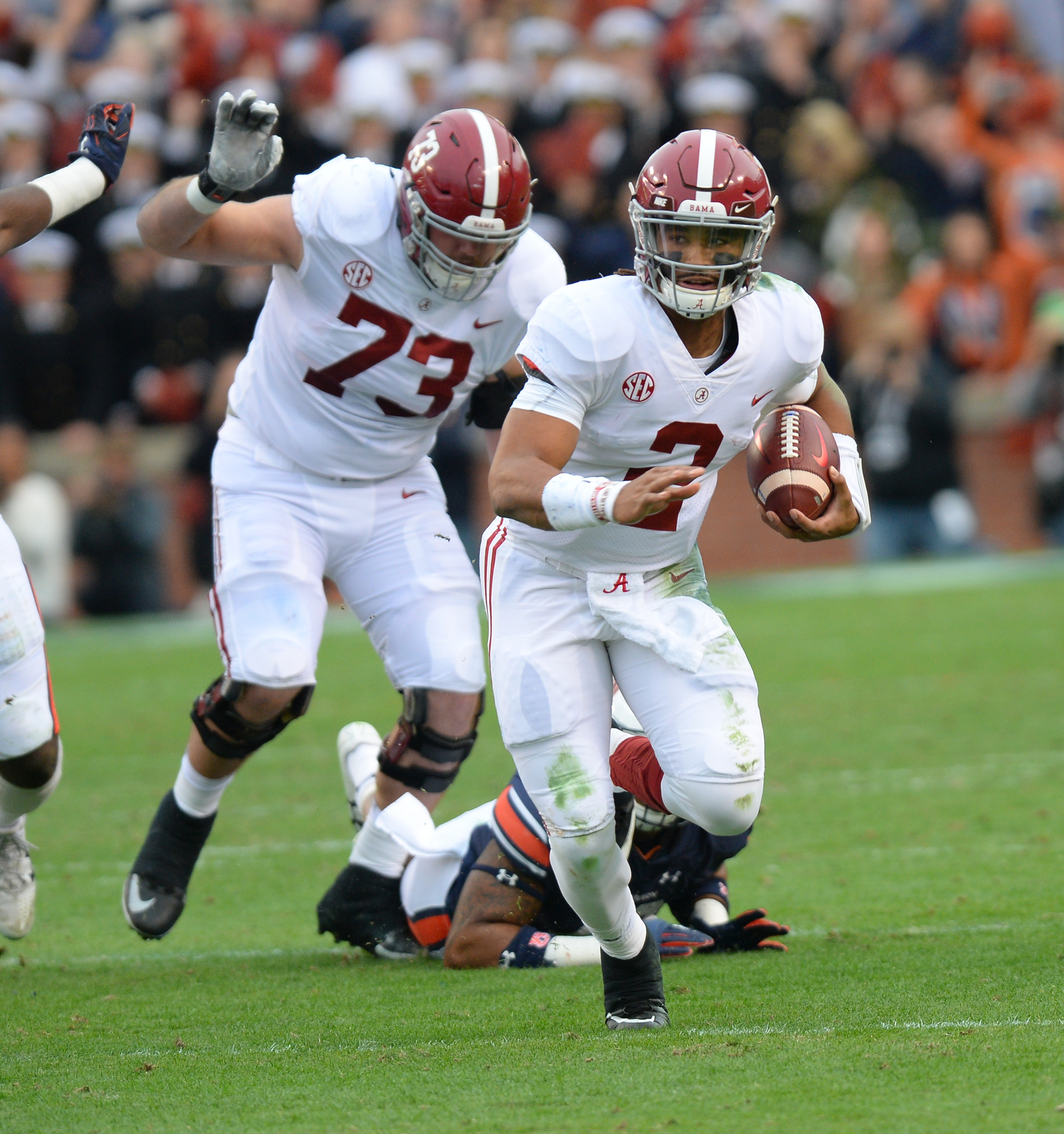 Alabama Crimson Tide quarterback Jalen Hurts (2) runs during the first half of Saturday's game, at Jordan-Hare Stadium.