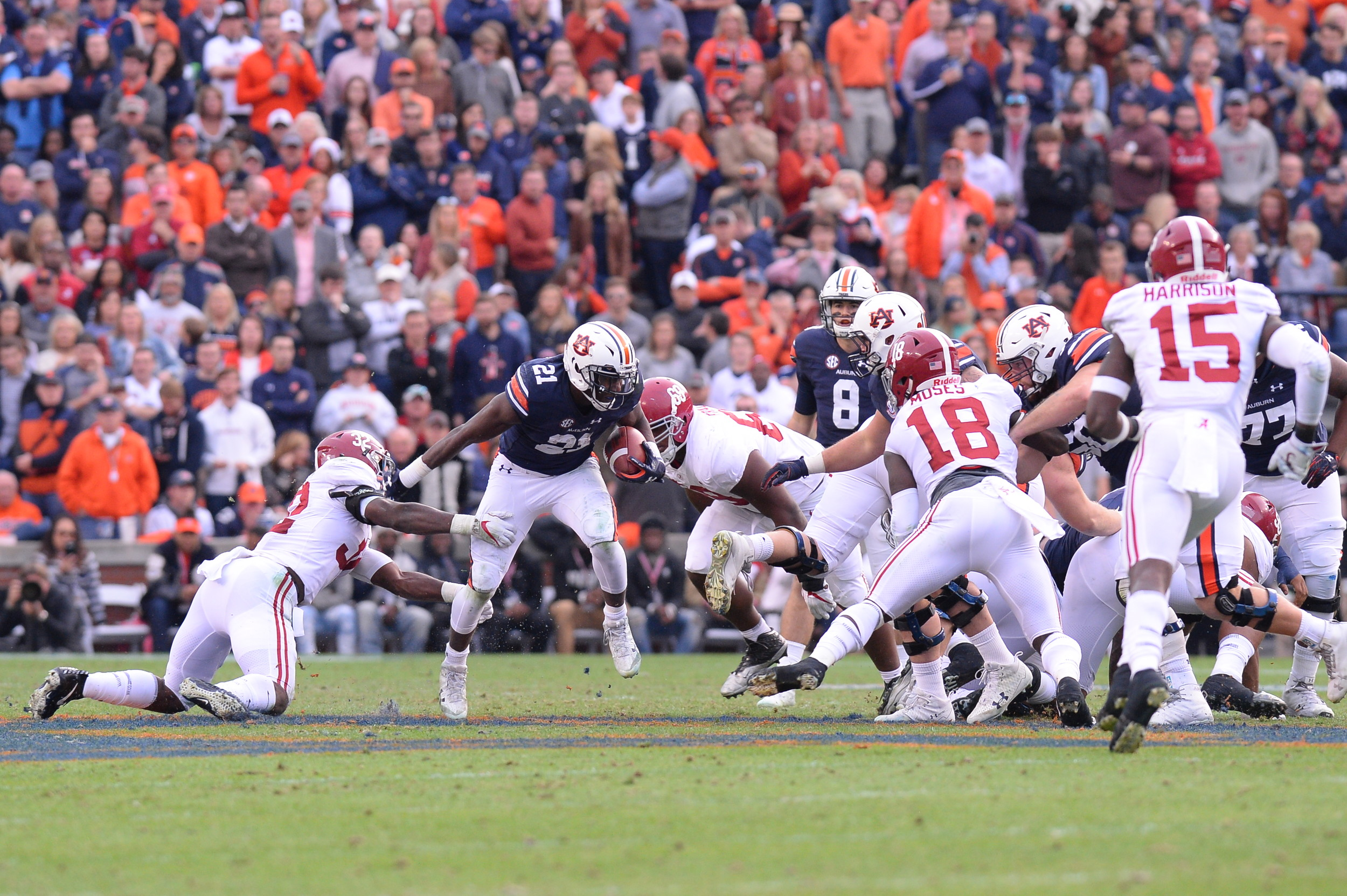 Auburn Tigers running back Kerryon Johnson (21) looks for an opening in the first half of the NCAA football game between the Alabama Crimson Tide and the Auburn Tigers on Nov. 25, 2017, at Jordan-Hare Stadium in Auburn, Ala. (Photo by Jeff Johnsey)