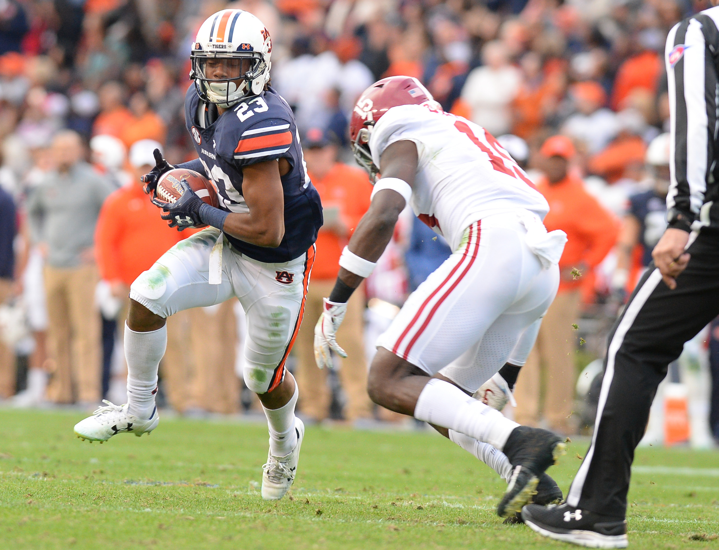 Auburn Tigers wide receiver Ryan Davis (23) eye Alabama Crimson Tide defensive back Ronnie Harrison (15) during the first half of Saturday's game, at Jordan-Hare Stadium.