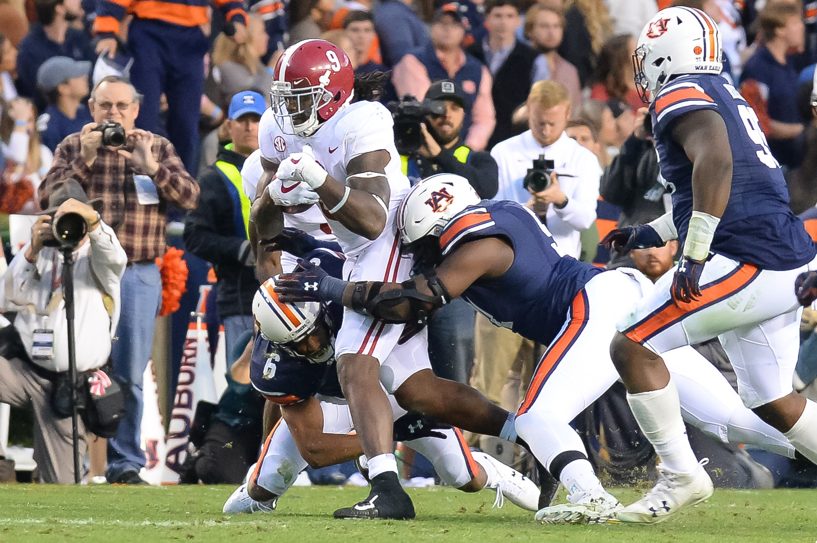 Alabama Crimson Tide running back Bo Scarbrough is tackled by Auburn Tigers defensive back Carlton Davis (6) during the second half during the second half of Auburn's 26-14 win over Alabama Saturday at Jordan-Hare Stadium.