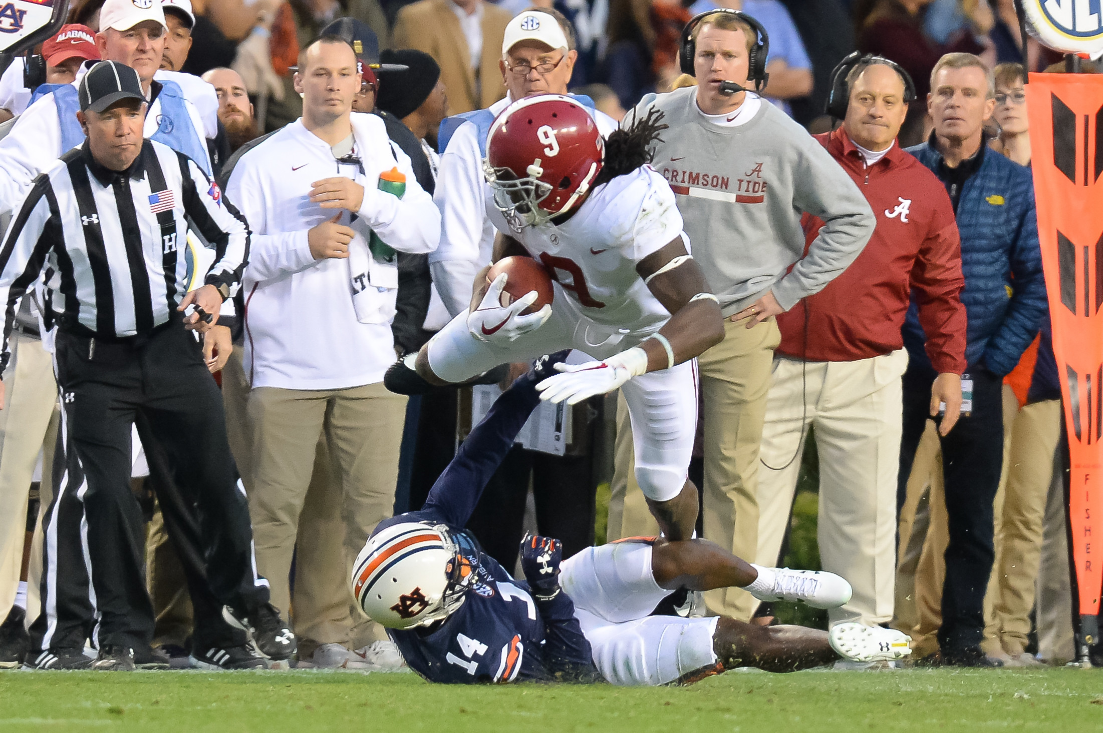 Alabama Crimson Tide running back Bo Scarbrough (9) is tackled by Auburn Tigers defensive back Stephen Roberts (14) during the second half of Saturday's game, at Jordan-Hare Stadium.