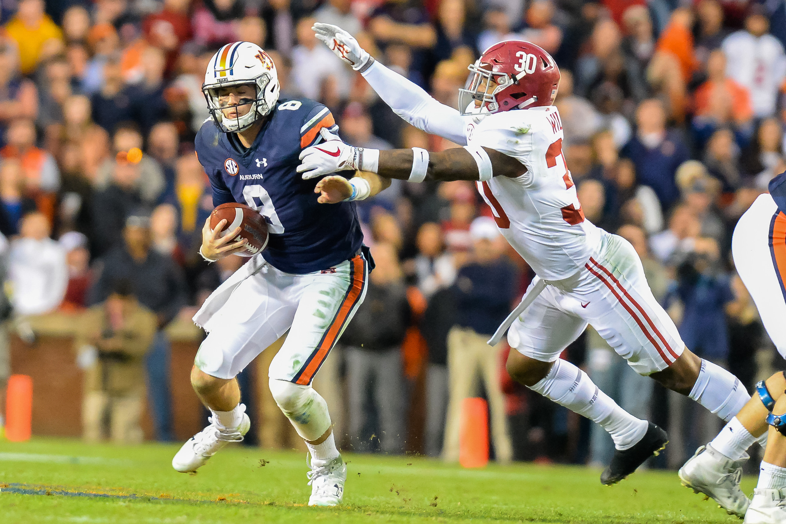 Alabama Crimson Tide linebacker Mack Wilson (30) pressures Auburn Tigers quarterback Jarrett Stidham (8) during the second half of Saturday's game, at Jordan-Hare Stadium.
