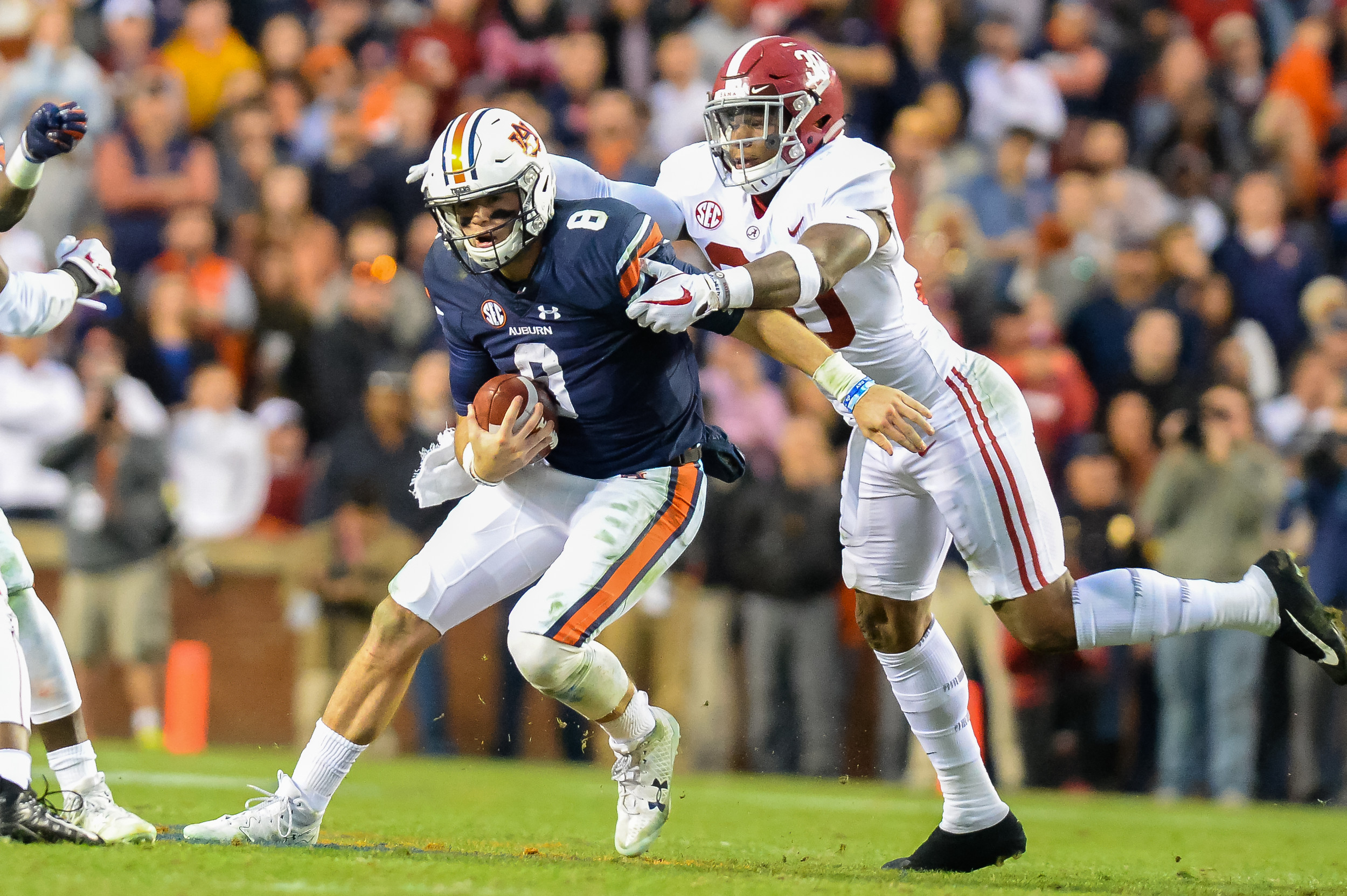Alabama Crimson Tide linebacker Mack Wilson (30) can't bring down Auburn Tigers quarterback Jarrett Stidham (8) during the second half of Saturday's game, at Jordan-Hare Stadium.