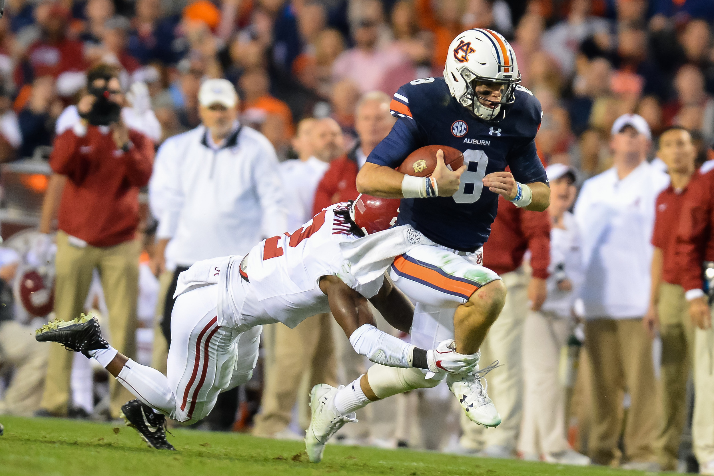 Alabama Crimson Tide defensive back Tony Brown (2) runs down Auburn Tigers quarterback Jarrett Stidham (8) during the second half of Saturday's game, at Jordan-Hare Stadium.
